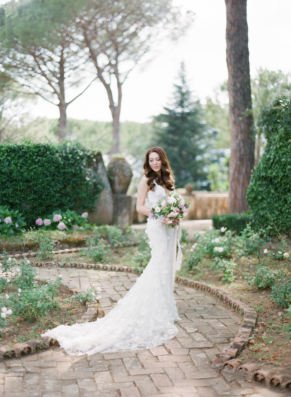 adrienne cameron wedding bride standing in garden