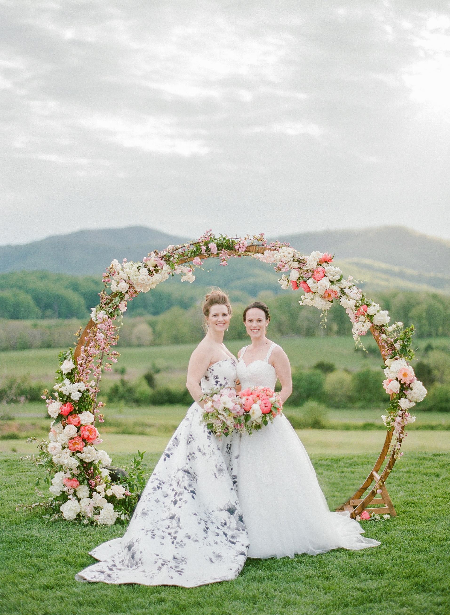mechelle julia wedding couple brides ceremony arch
