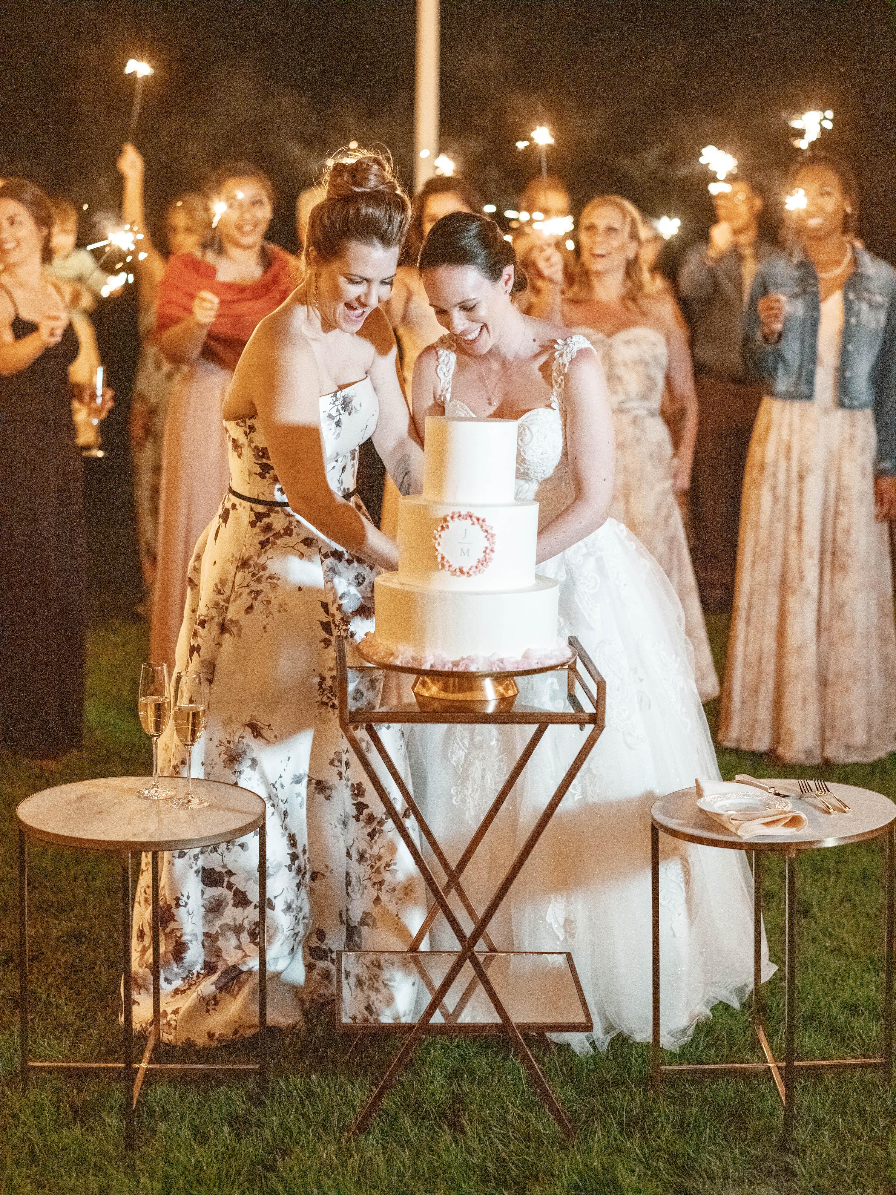 mechelle julia wedding cake cutting couple