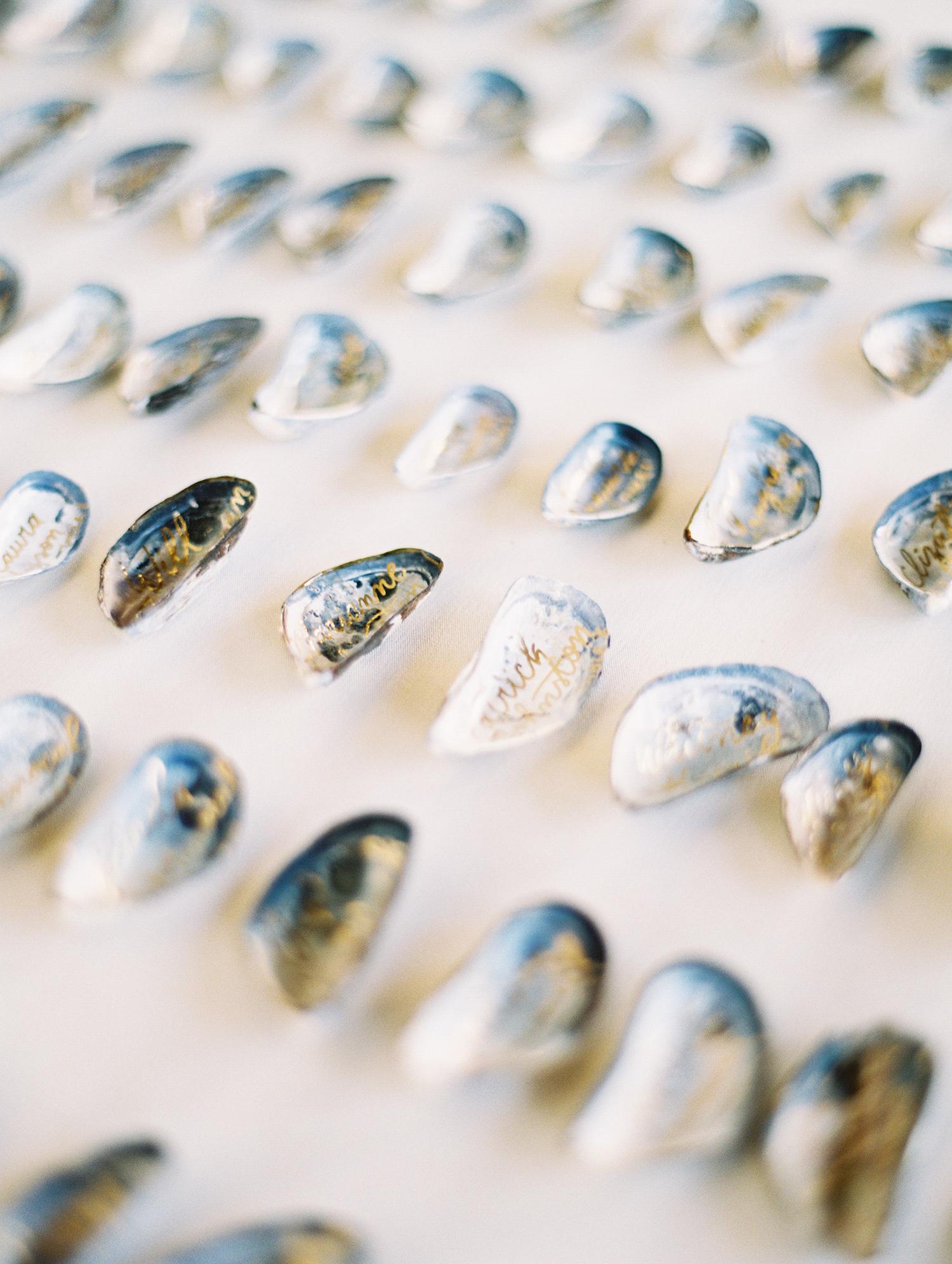 beth john wedding escort cards shells
