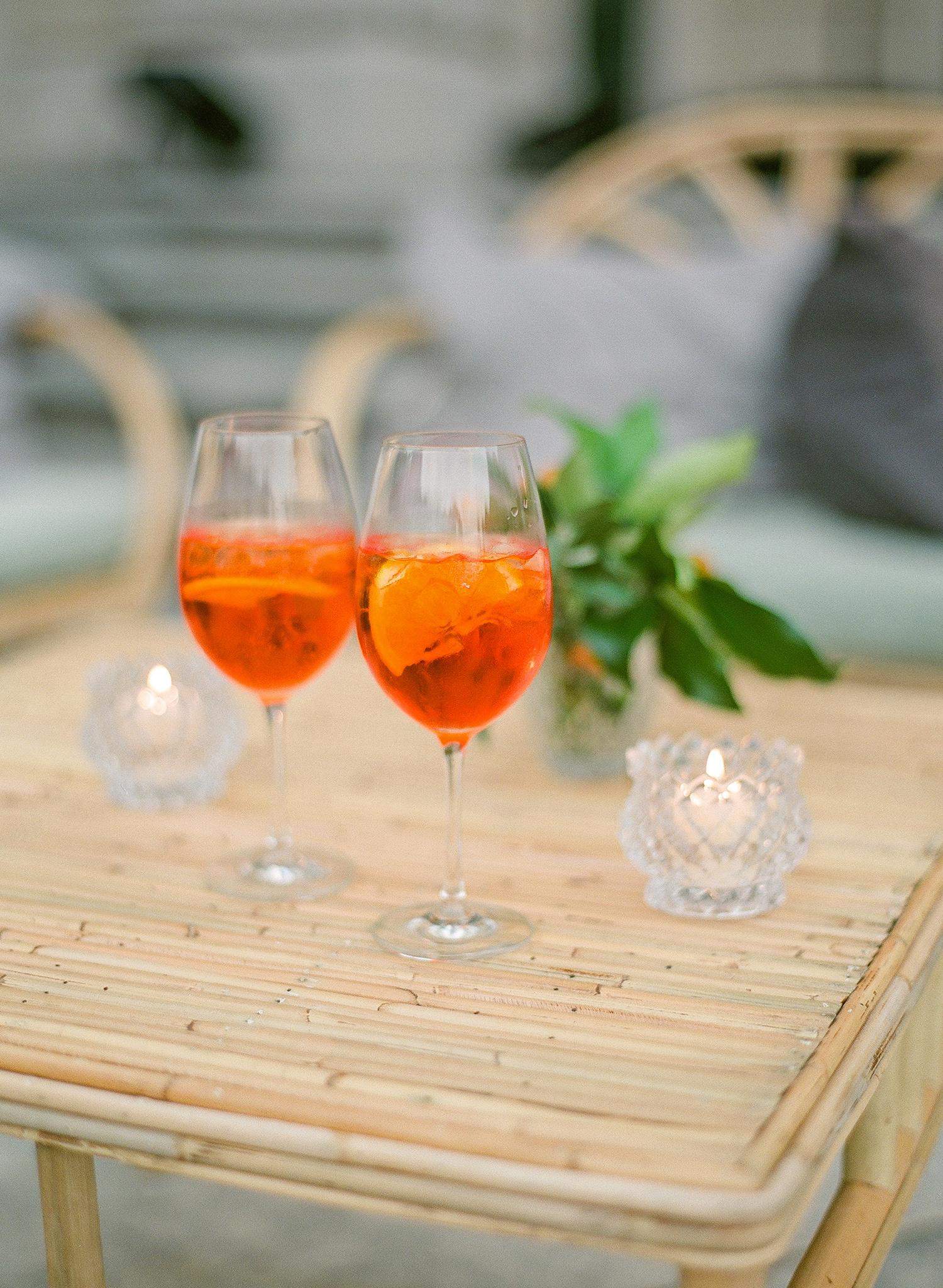 julia mauro wedding orange drinks on table