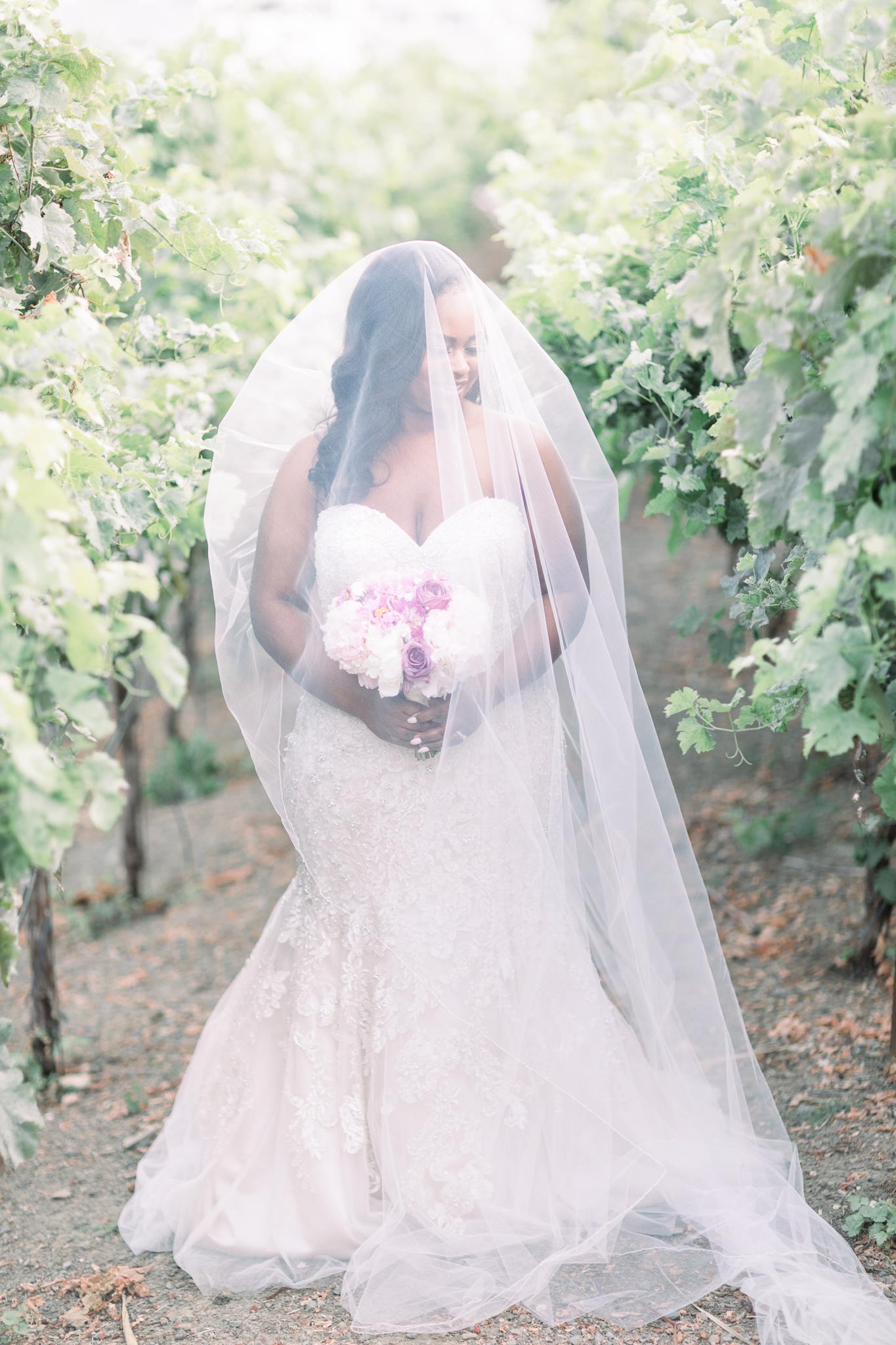 bride standing outside in strapless dress silk champagne underlay