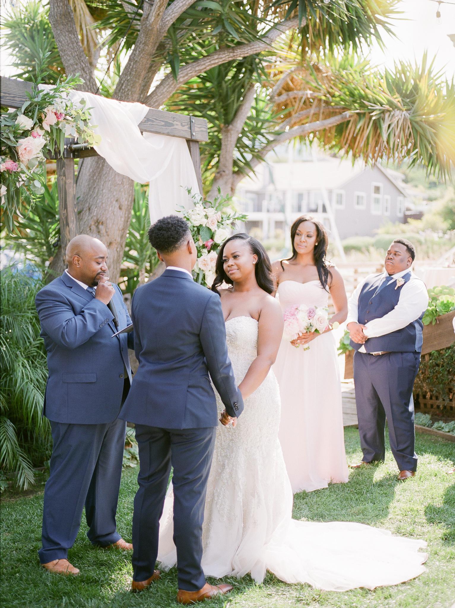 outdoor wedding ceremony vows wooden archway