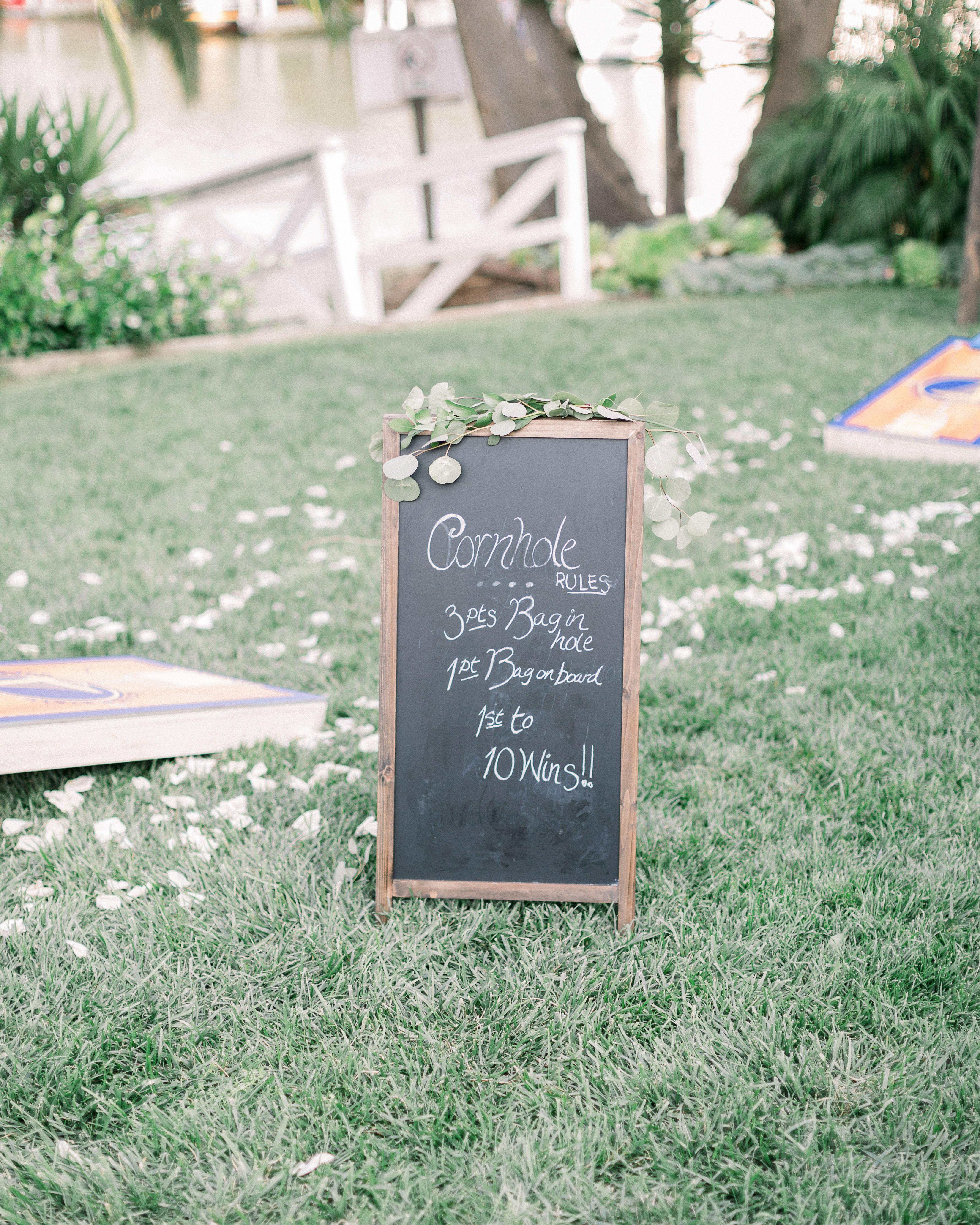 wedding lawn games chalkboard cornhole rules