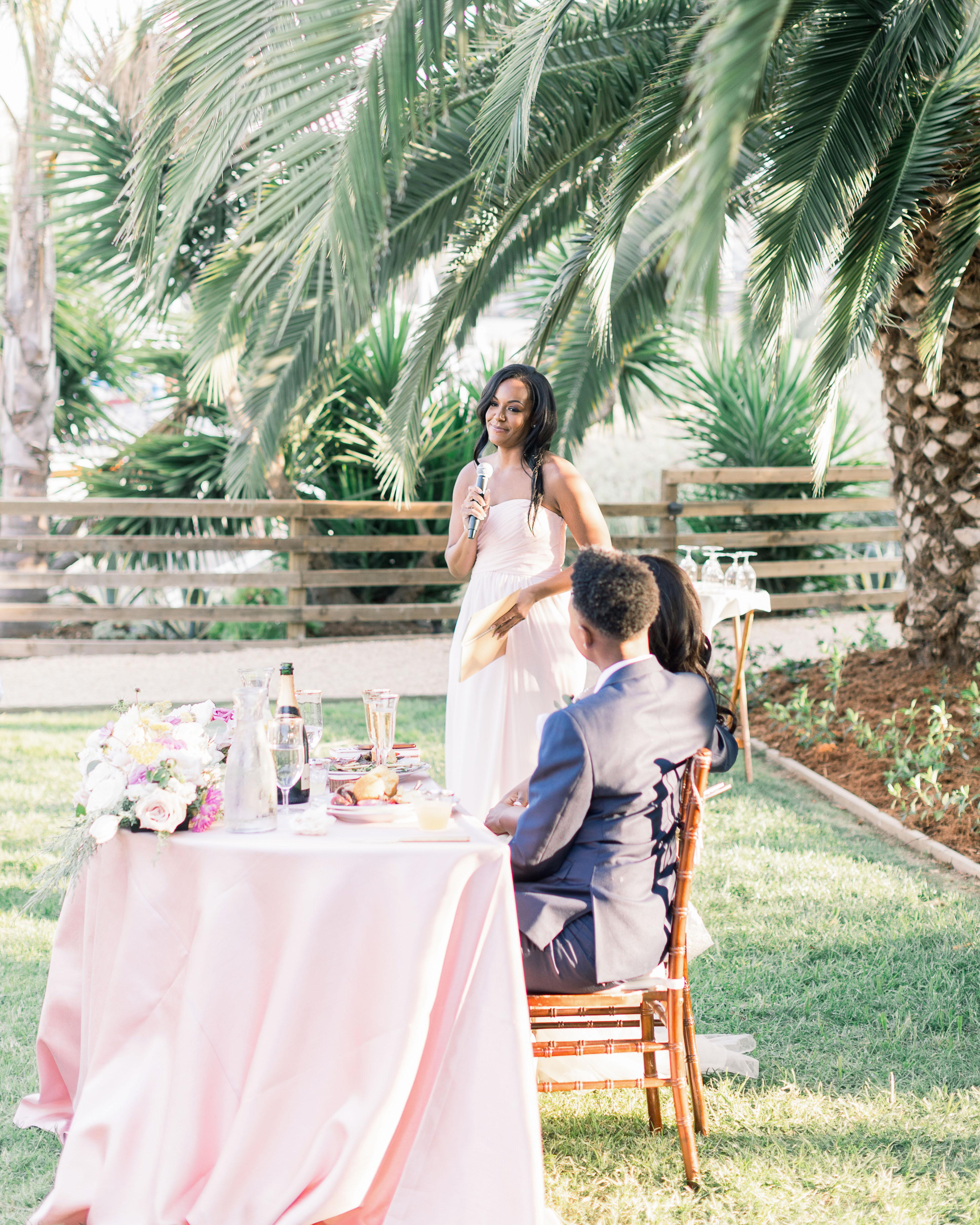 outdoor wedding reception couples table speech