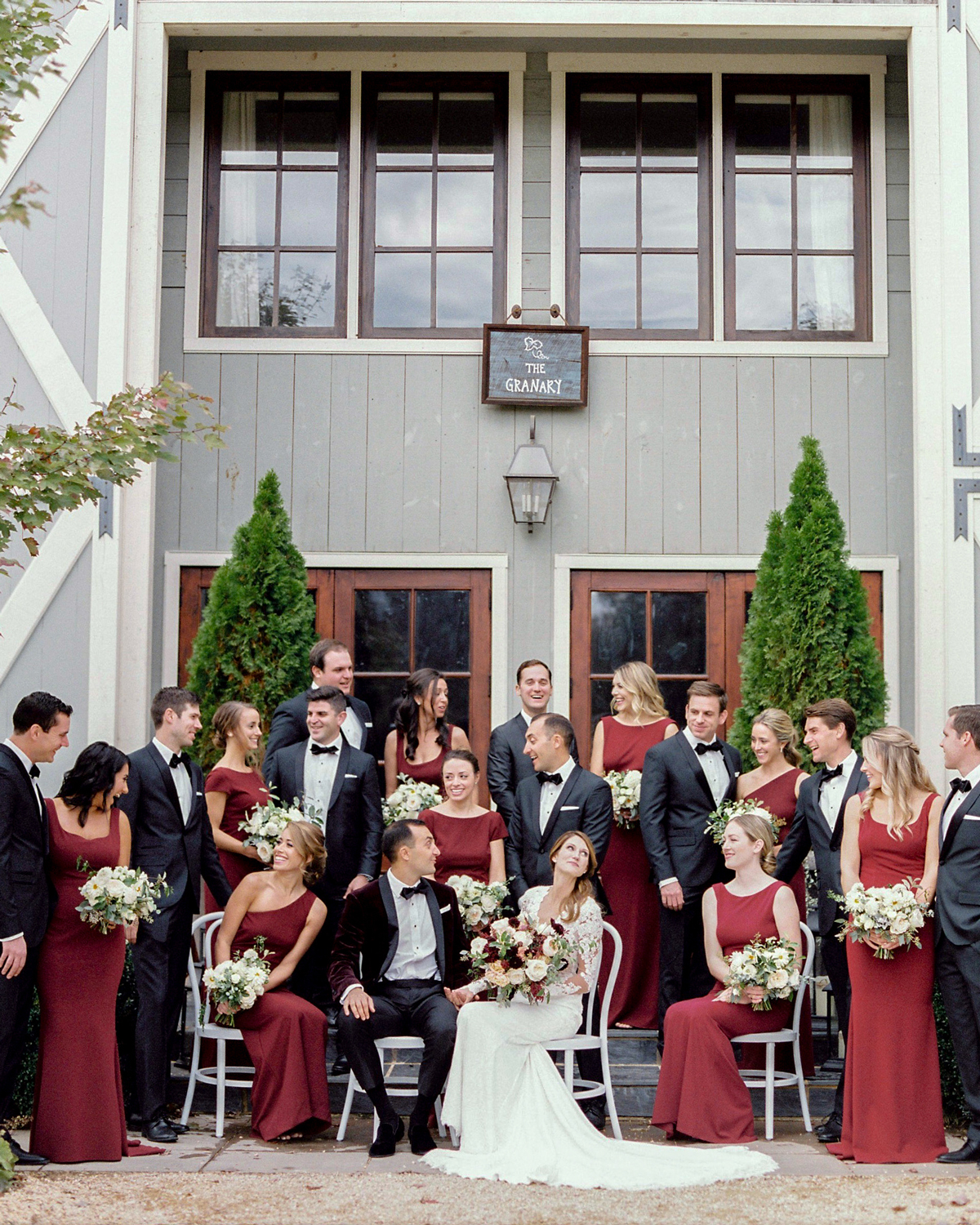 wedding party wearing red dresses and black suits