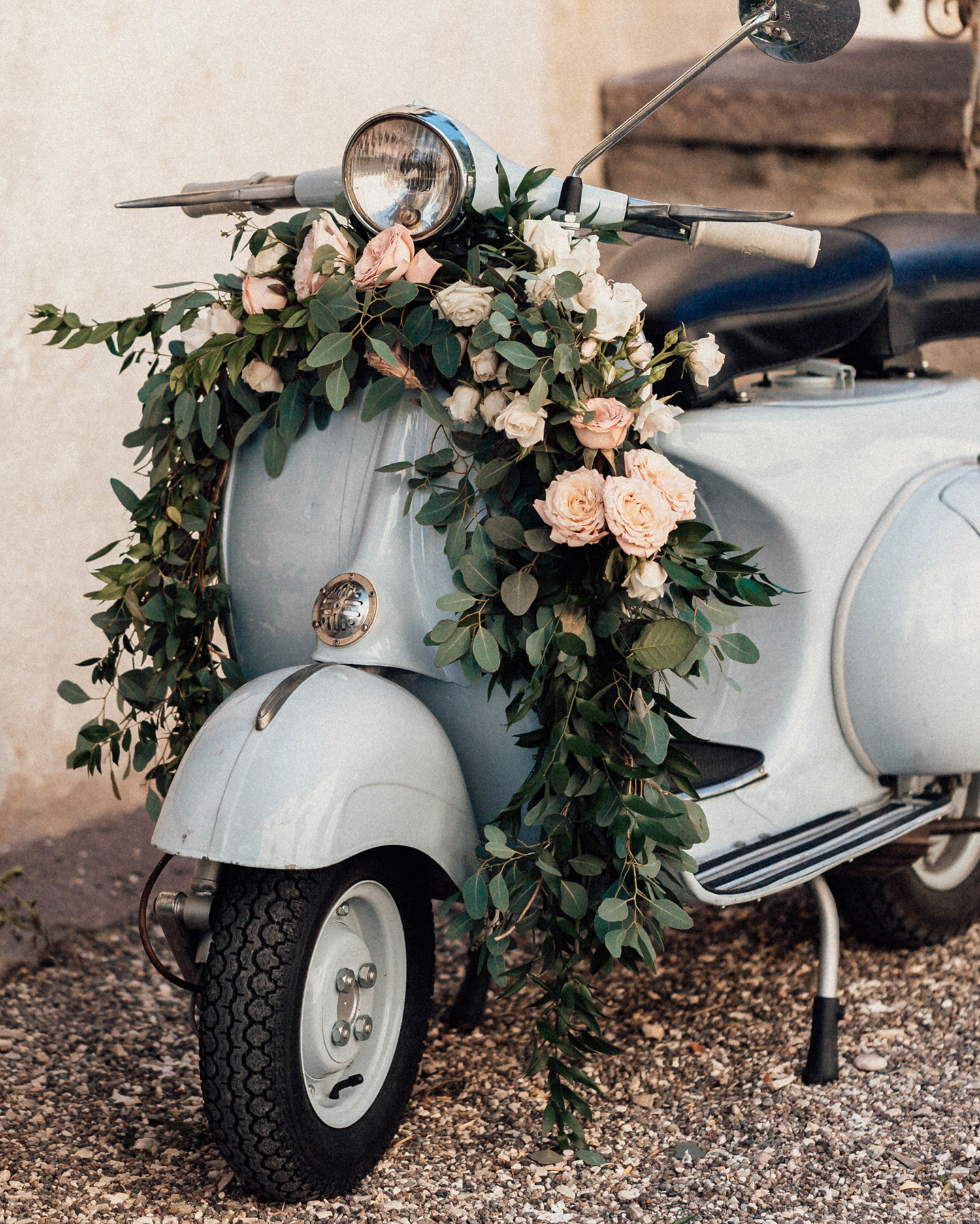 natalie paul wedding ceremony vespa with flowers