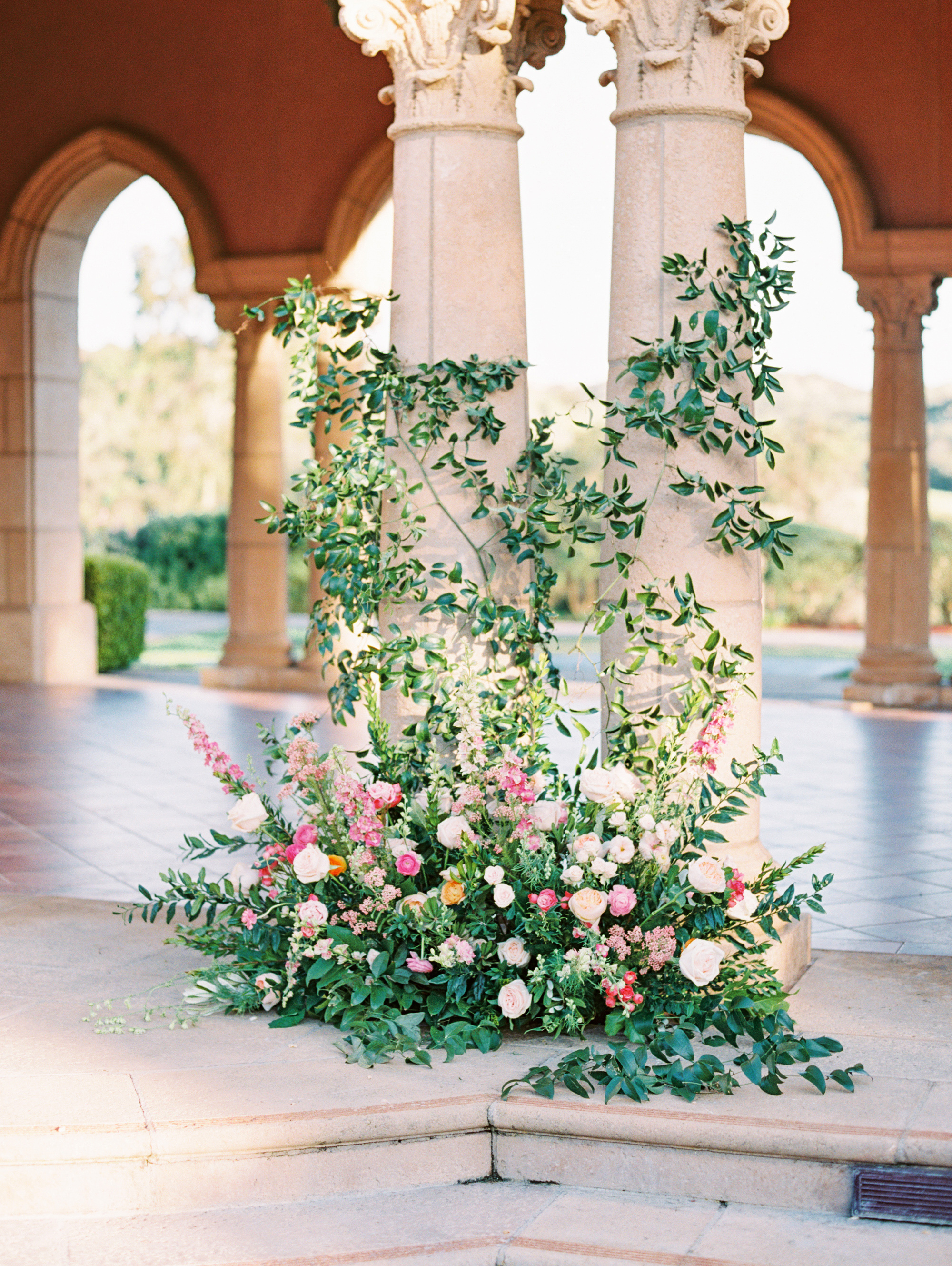 cavin david wedding floral installation in front of columns