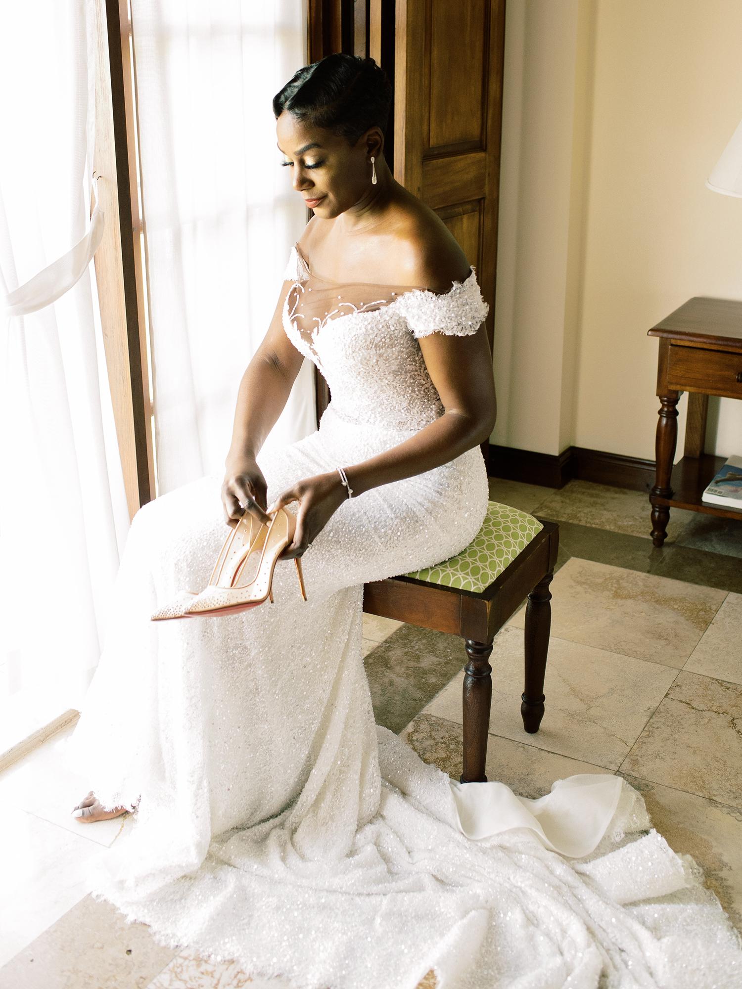 melissa leighton wedding bride sitting by window