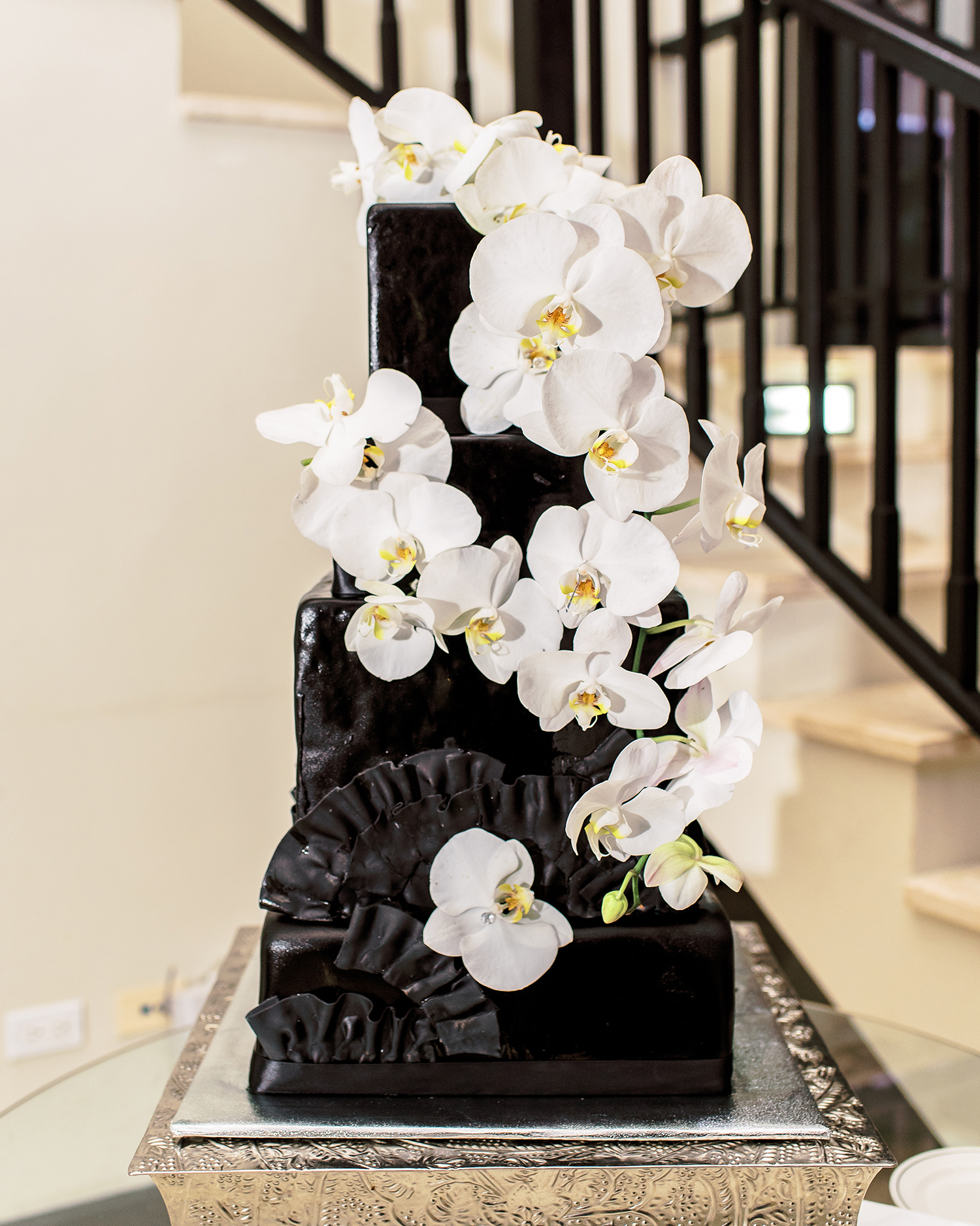 melissa leighton black ruffled white flower wedding cake