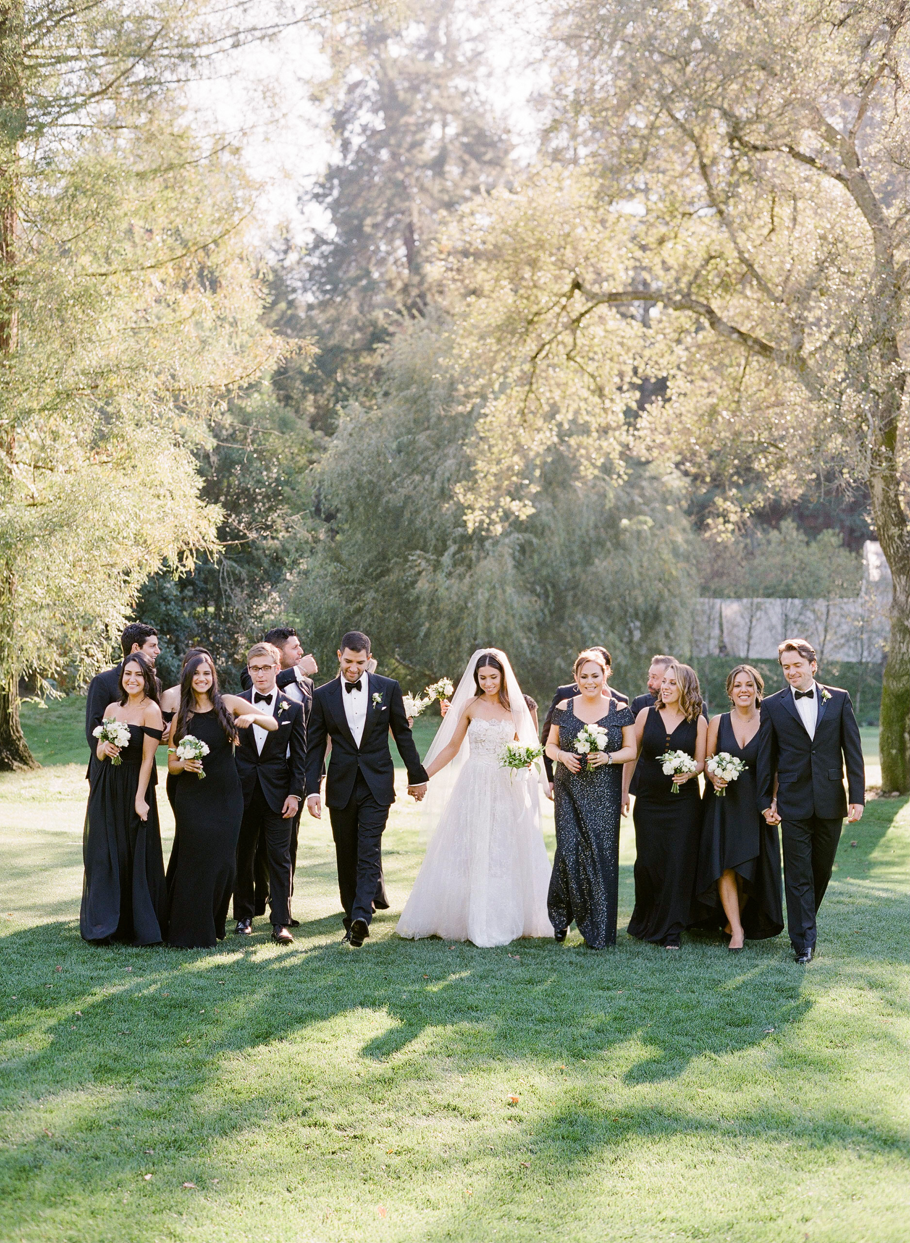wedding party walking outdoors