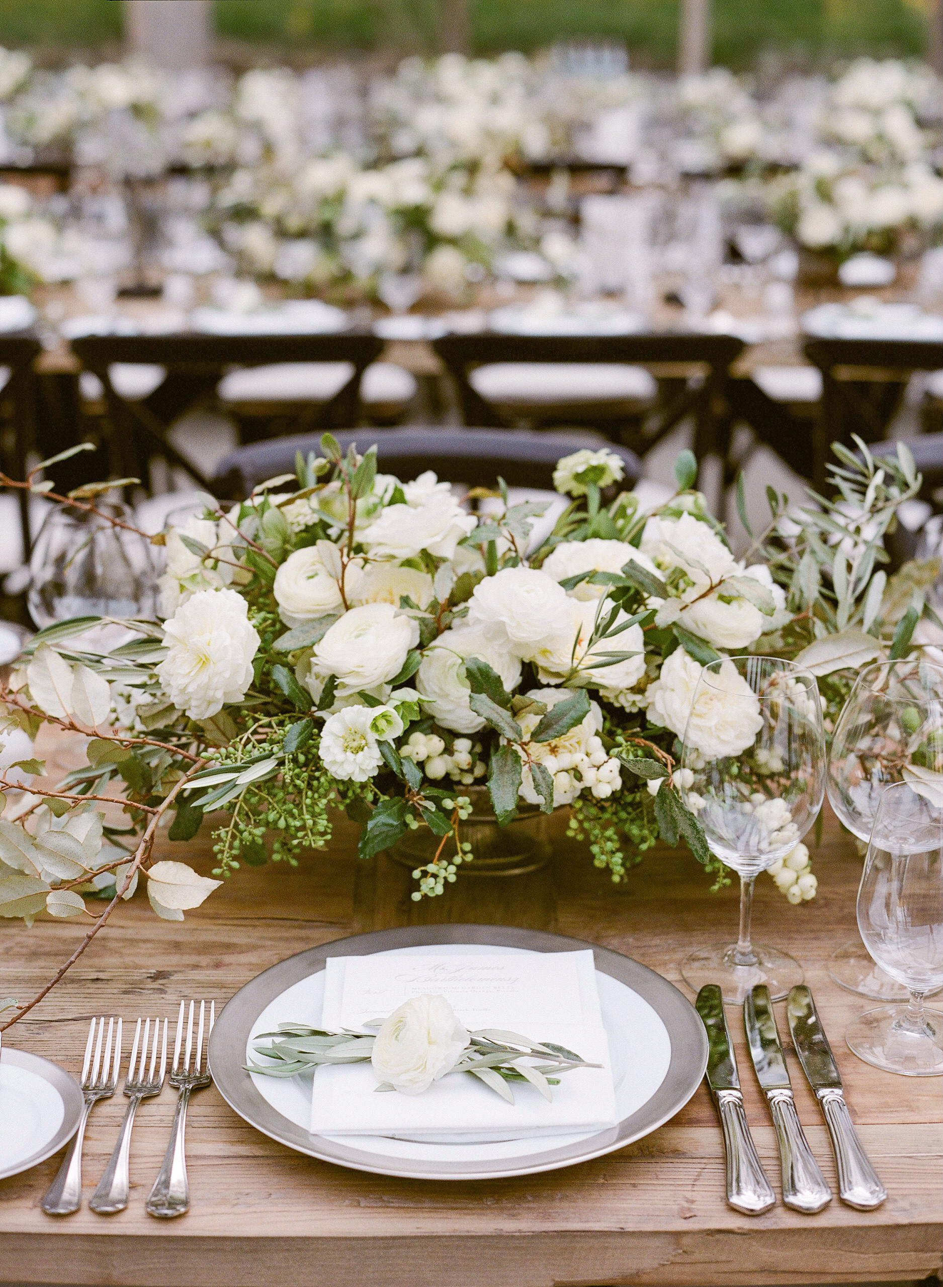 white floral centerpiece table setting menu