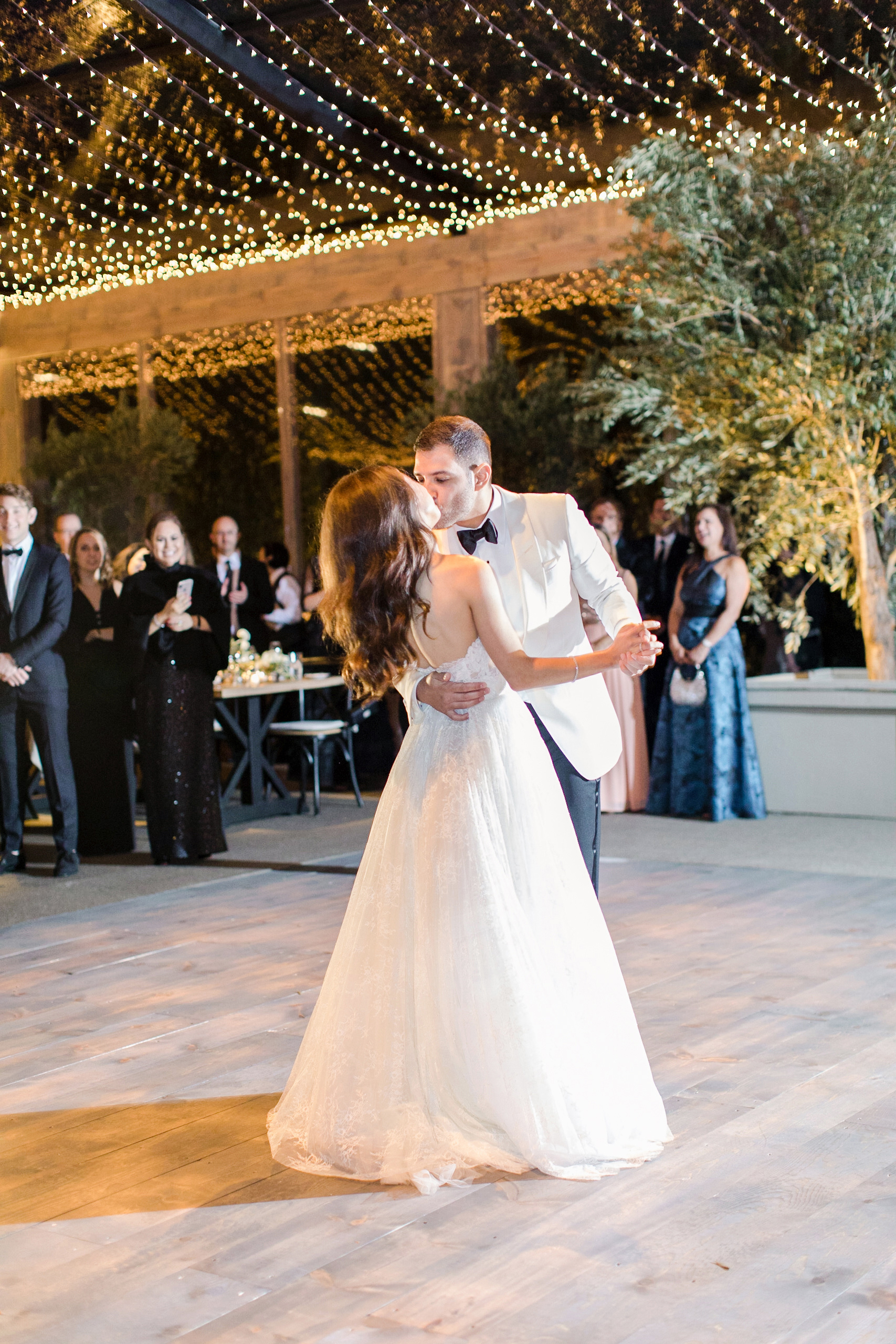 bride groom wedding reception first dance under string lights