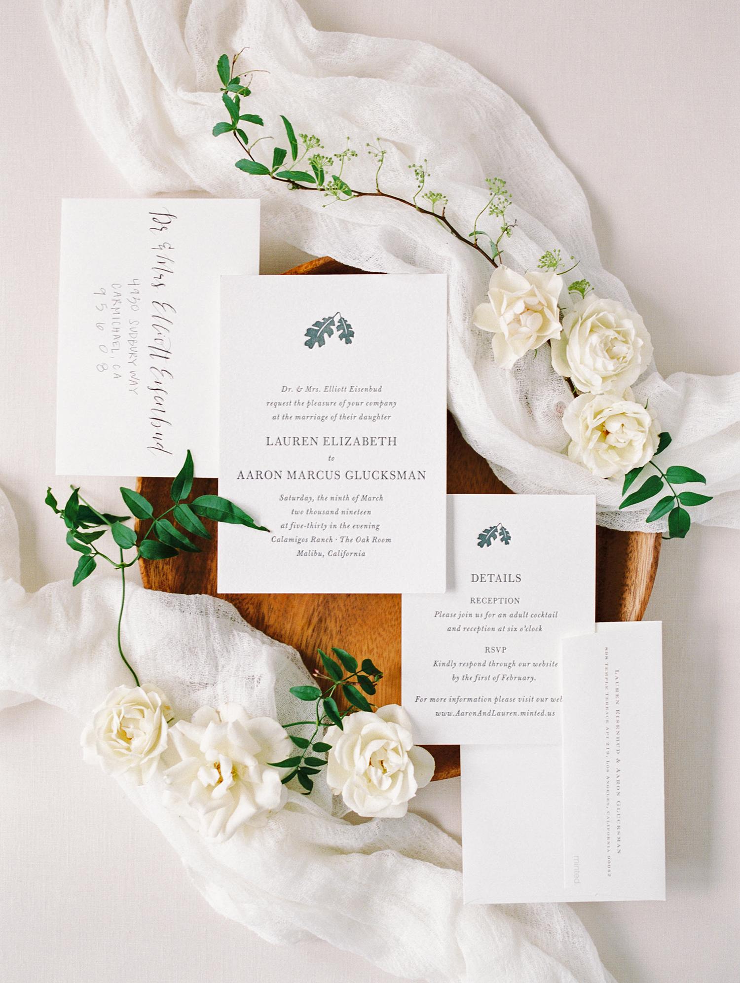 lauren aaron wedding invites and white flowers