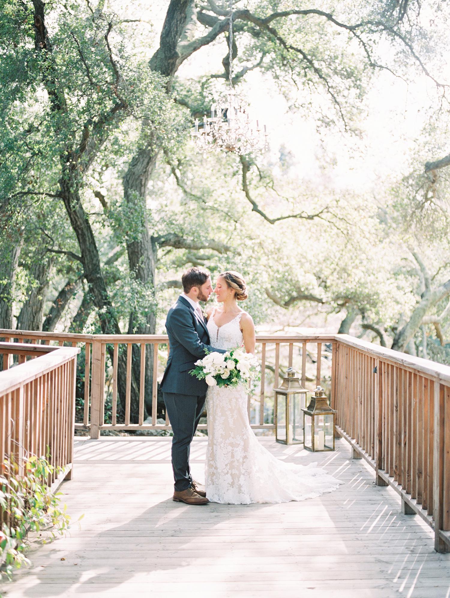 lauren aaron wedding couple on bridge
