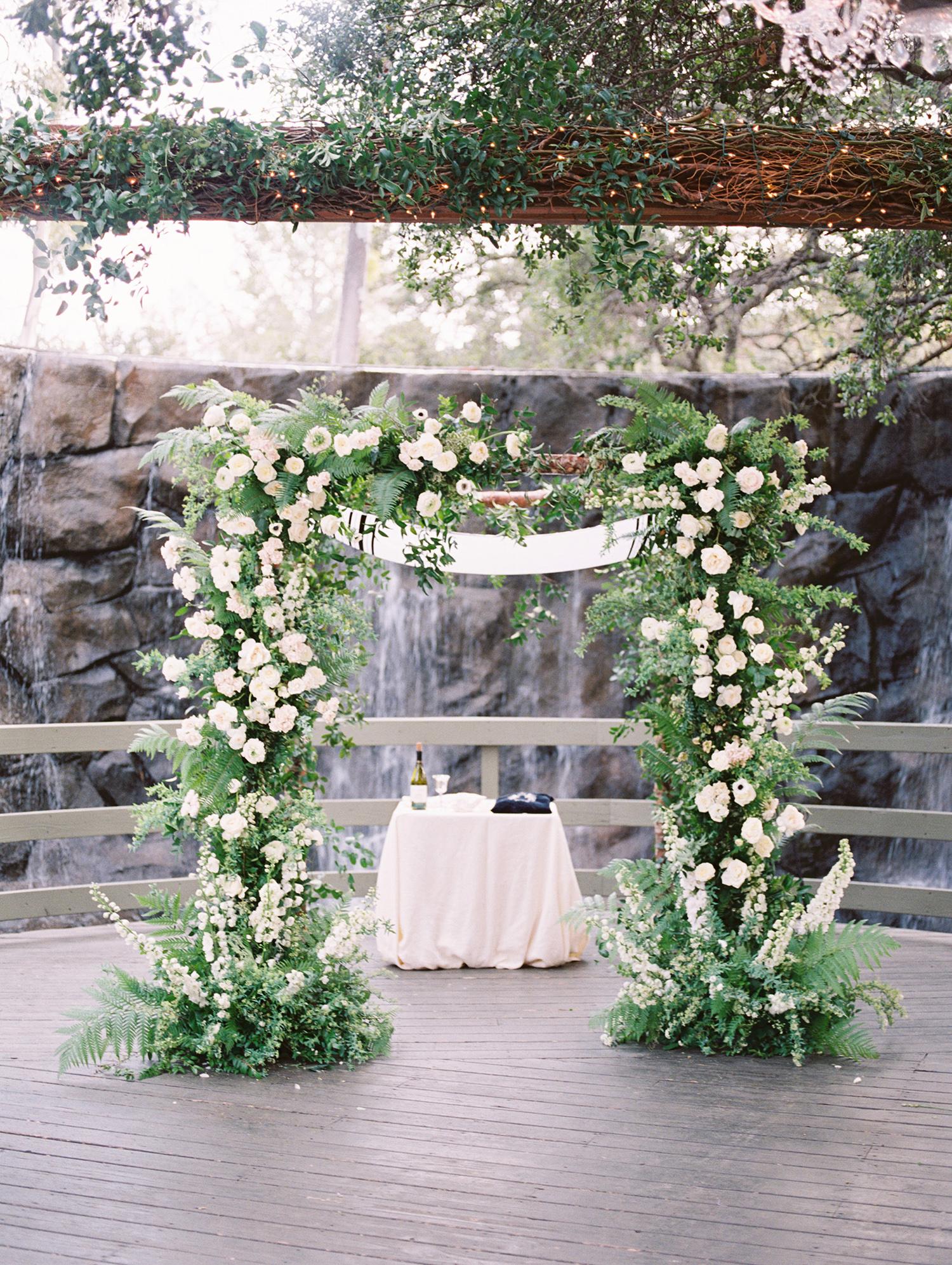 lauren aaron wedding ceremony location in front of waterfall