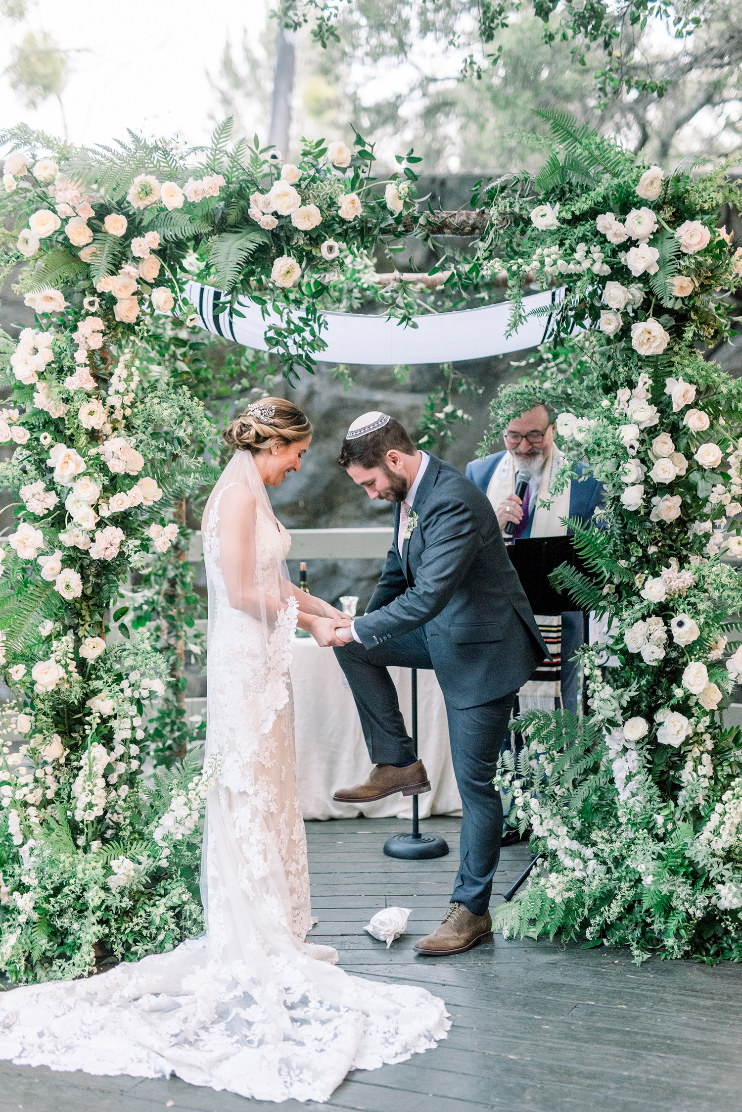 lauren aaron wedding groom stomping glass
