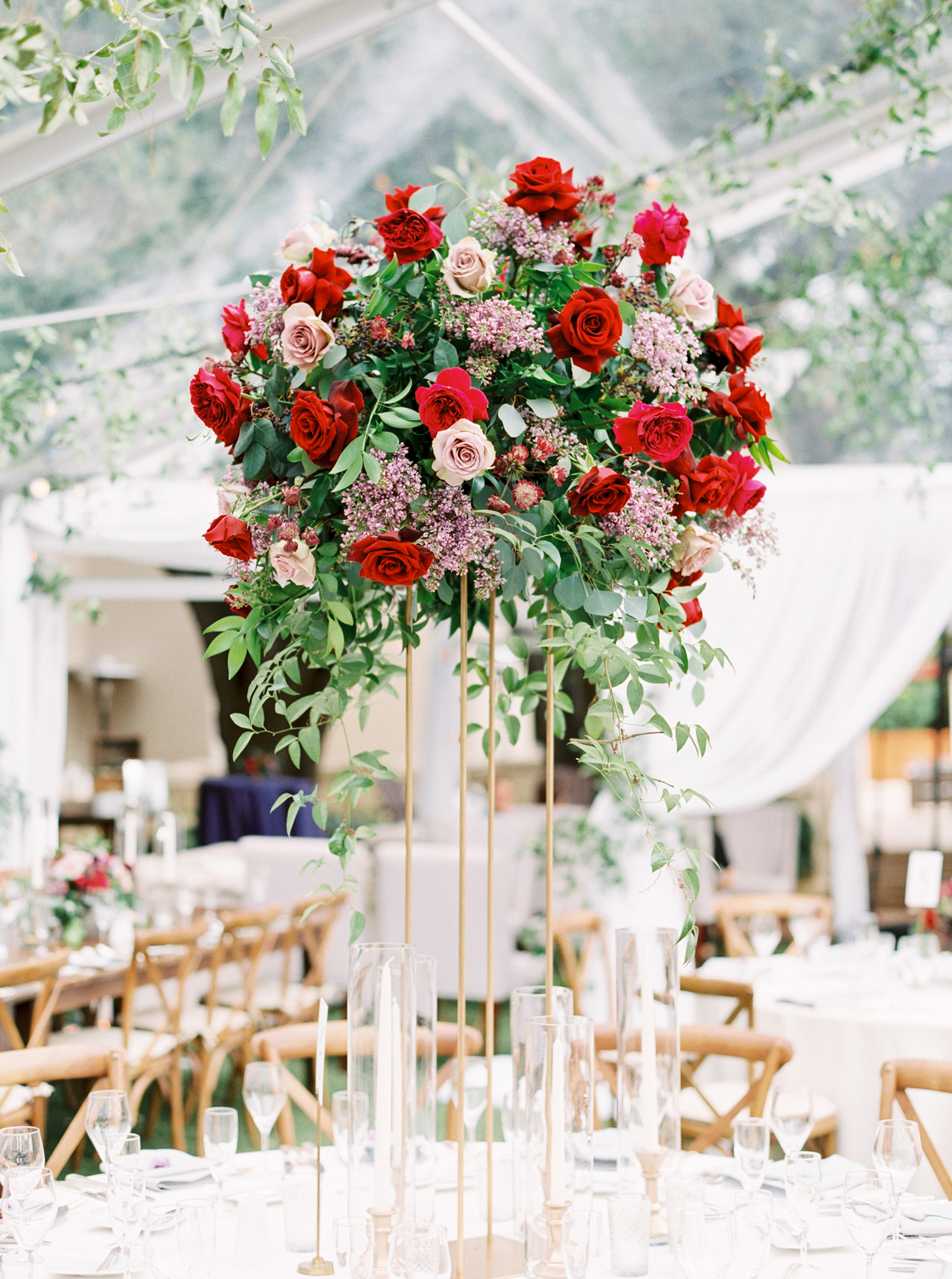 tall centerpiece with red and pink garden roses
