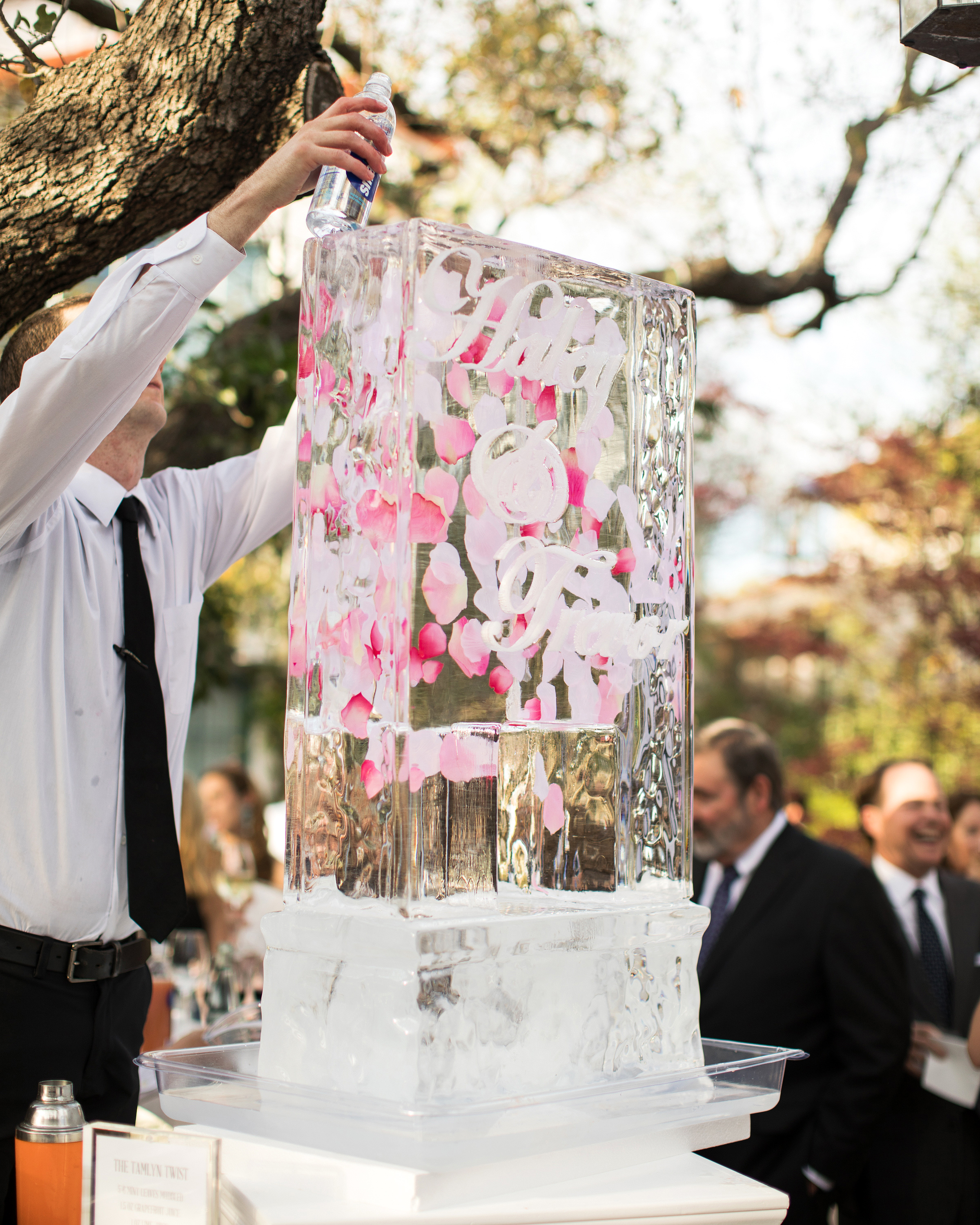wedding ice sculpture rose petals drink station