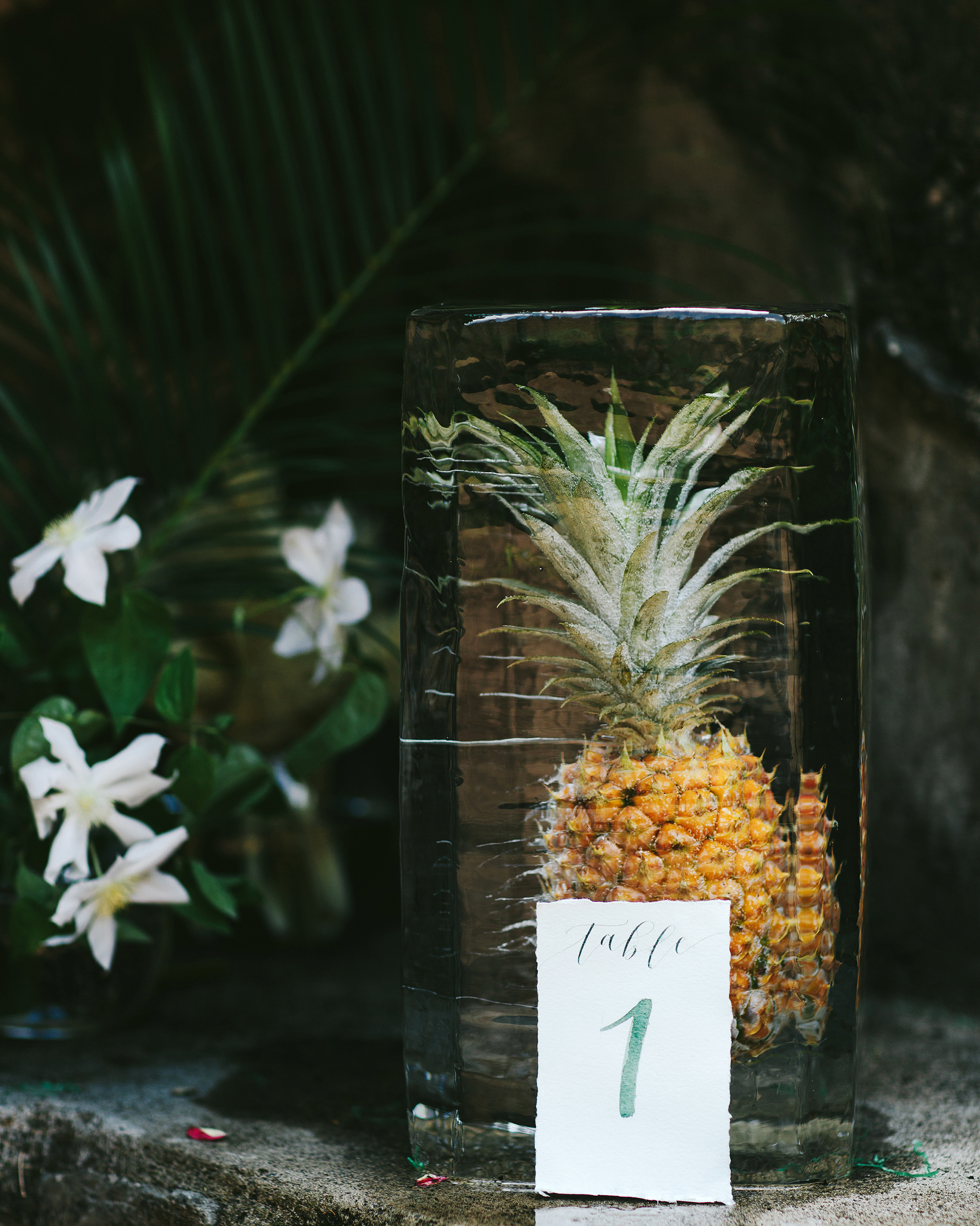 wedding ice sculpture frozen pineapple table numbers