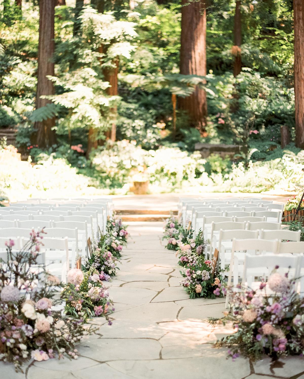 woodsy floral arrangements wedding aisle