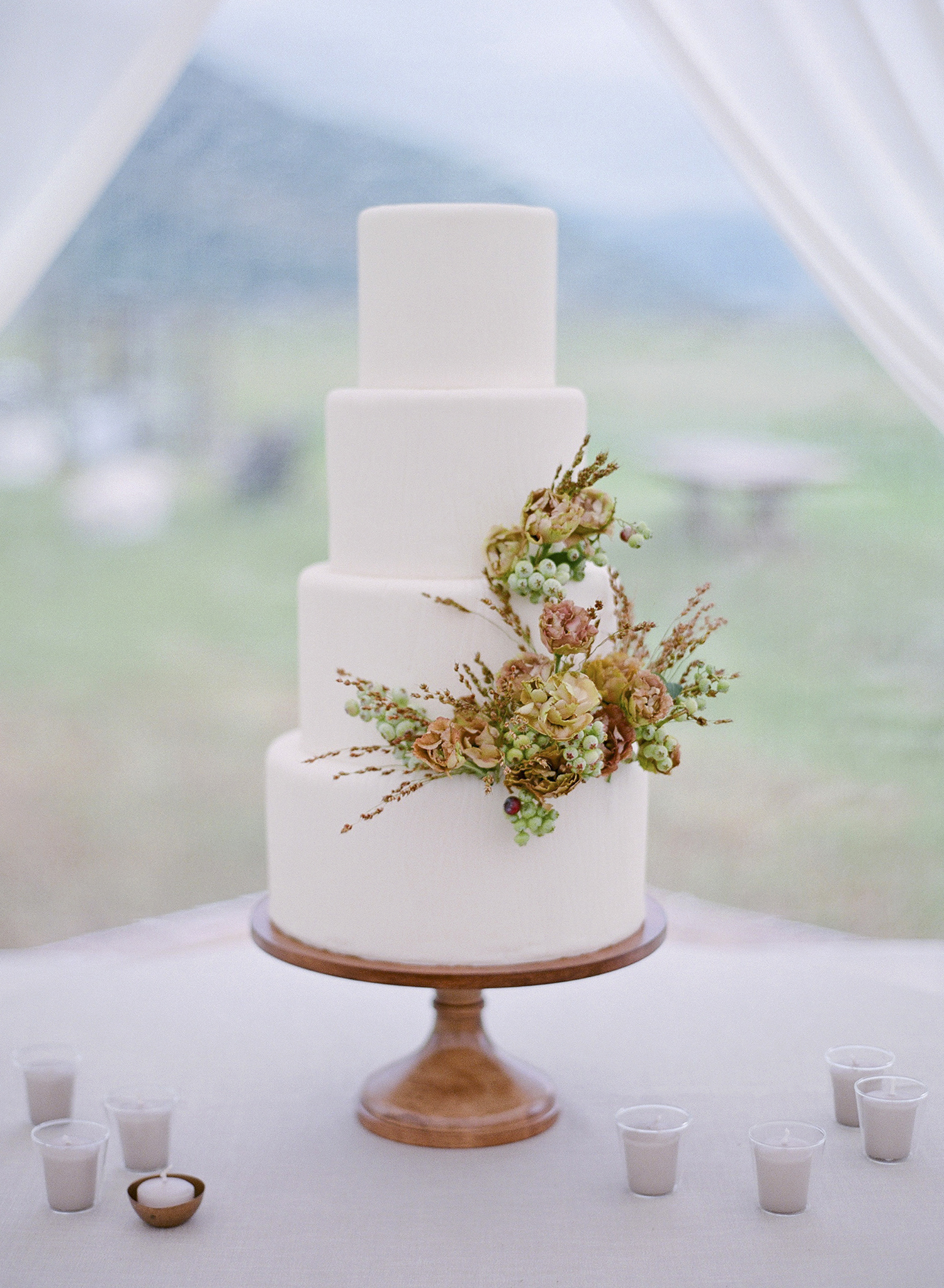 sloan scott wedding white cake with flowers