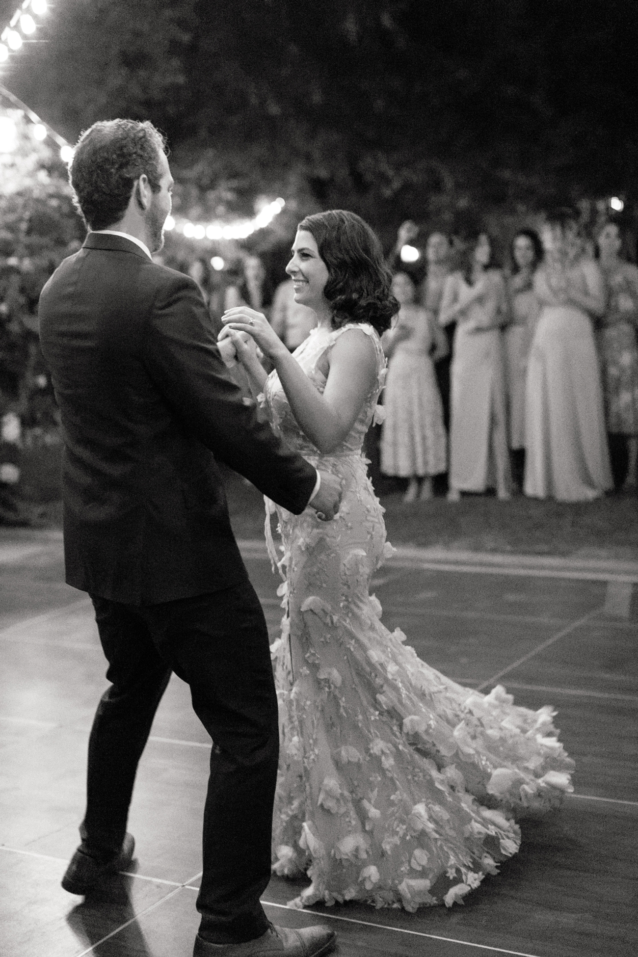 bride and groom share first dance on dance floor