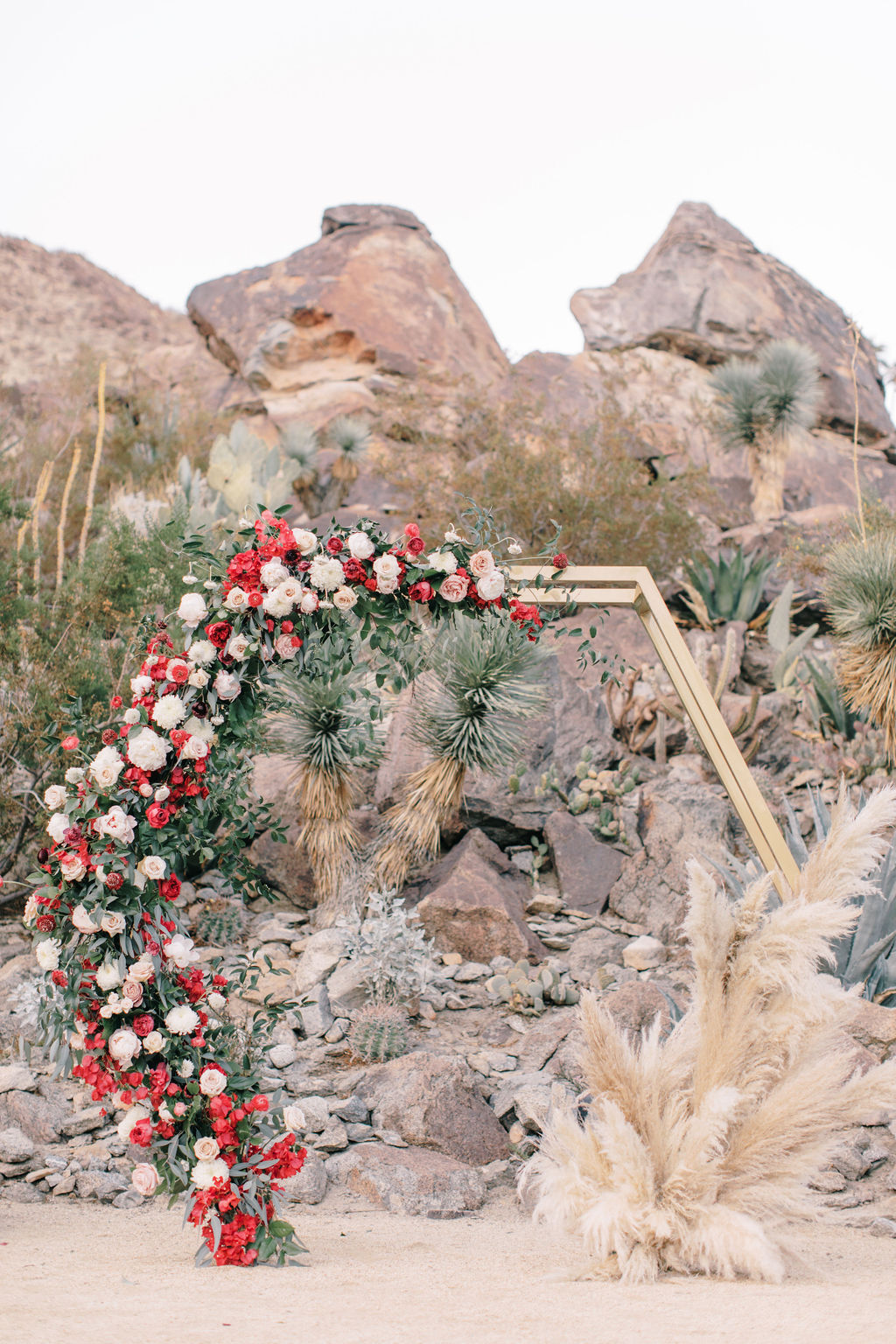 meagan robert wedding red roses arch