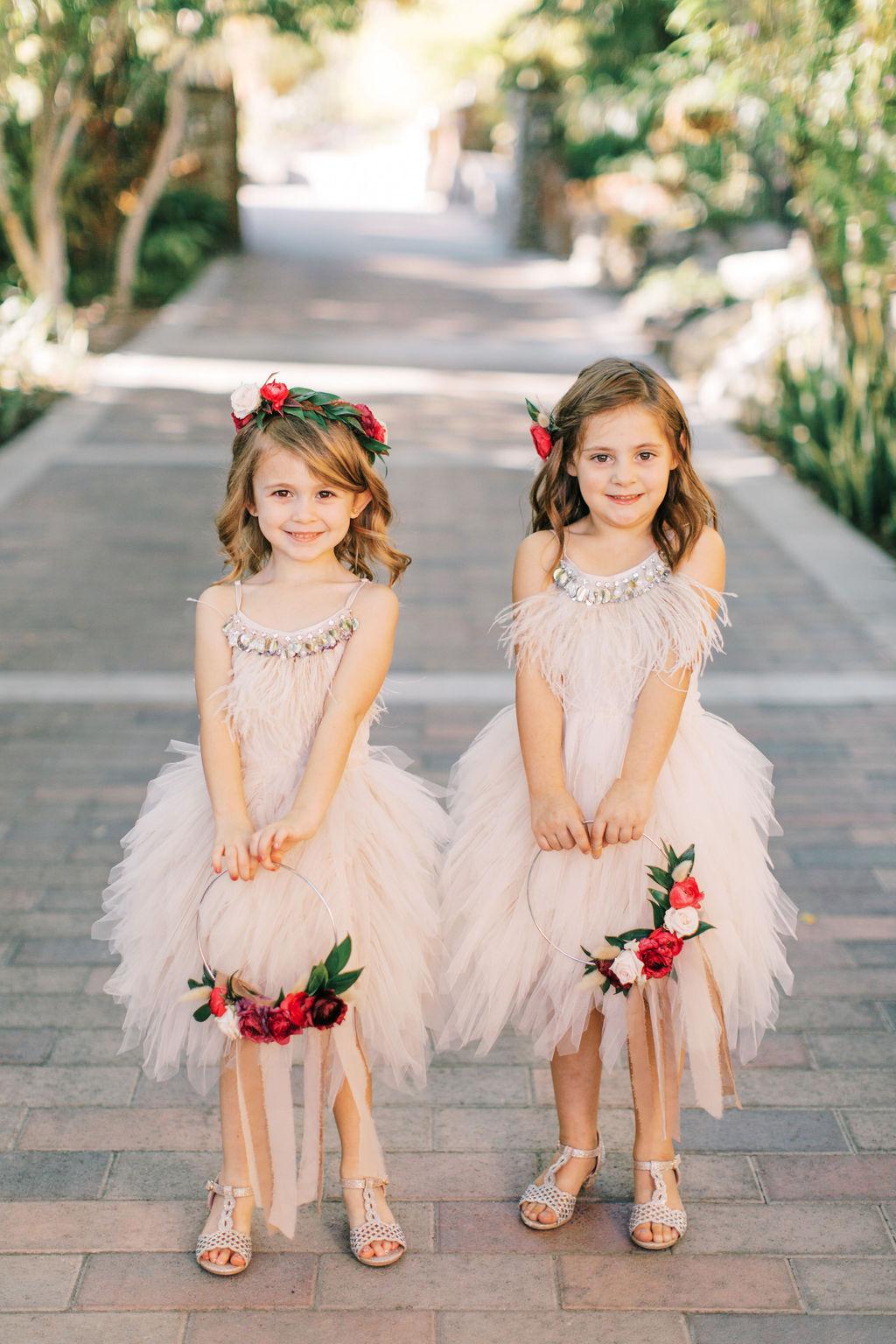 meagan robert wedding flower girls in mauve tool dresses holding baskets