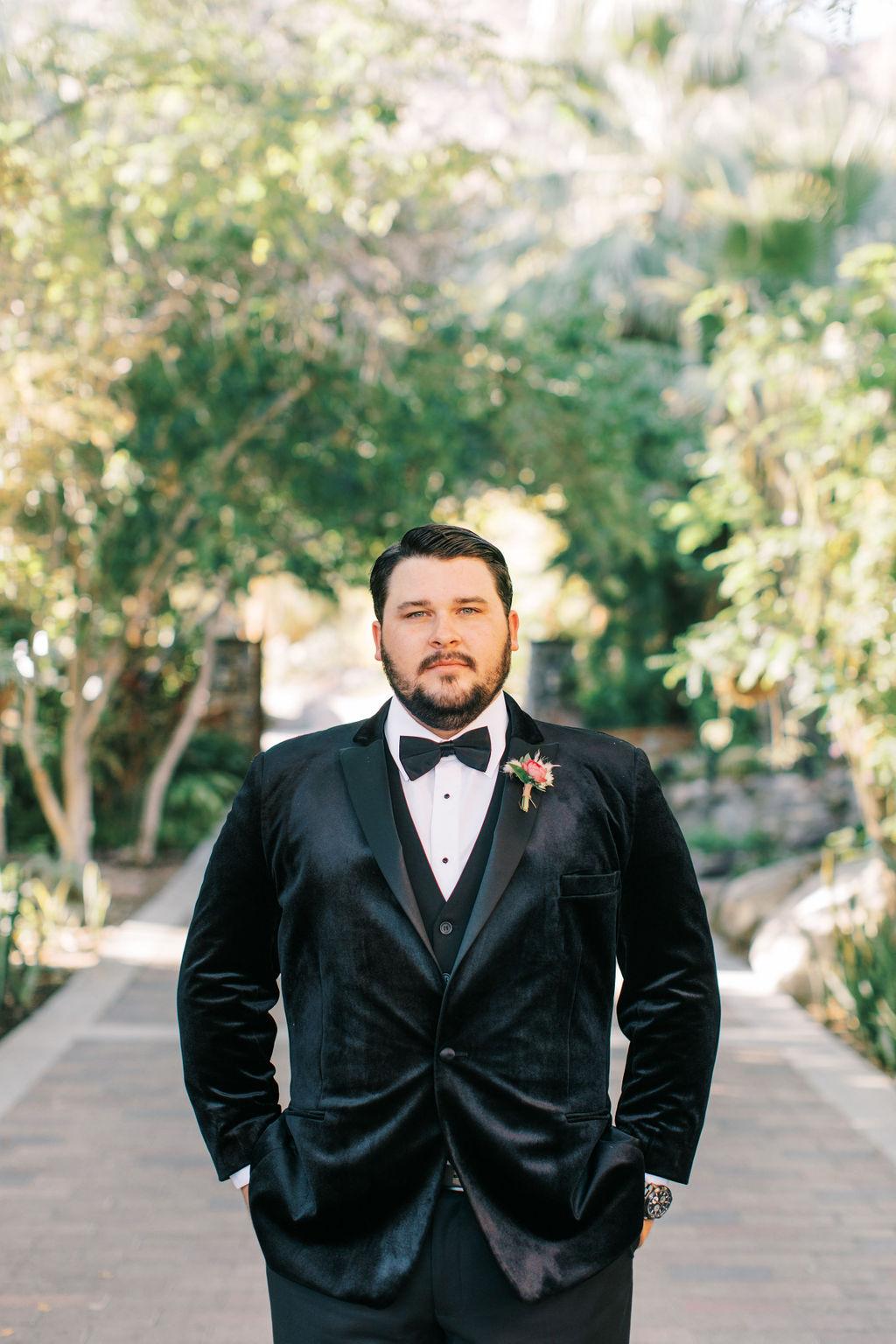 meagan robert wedding groom in black suit