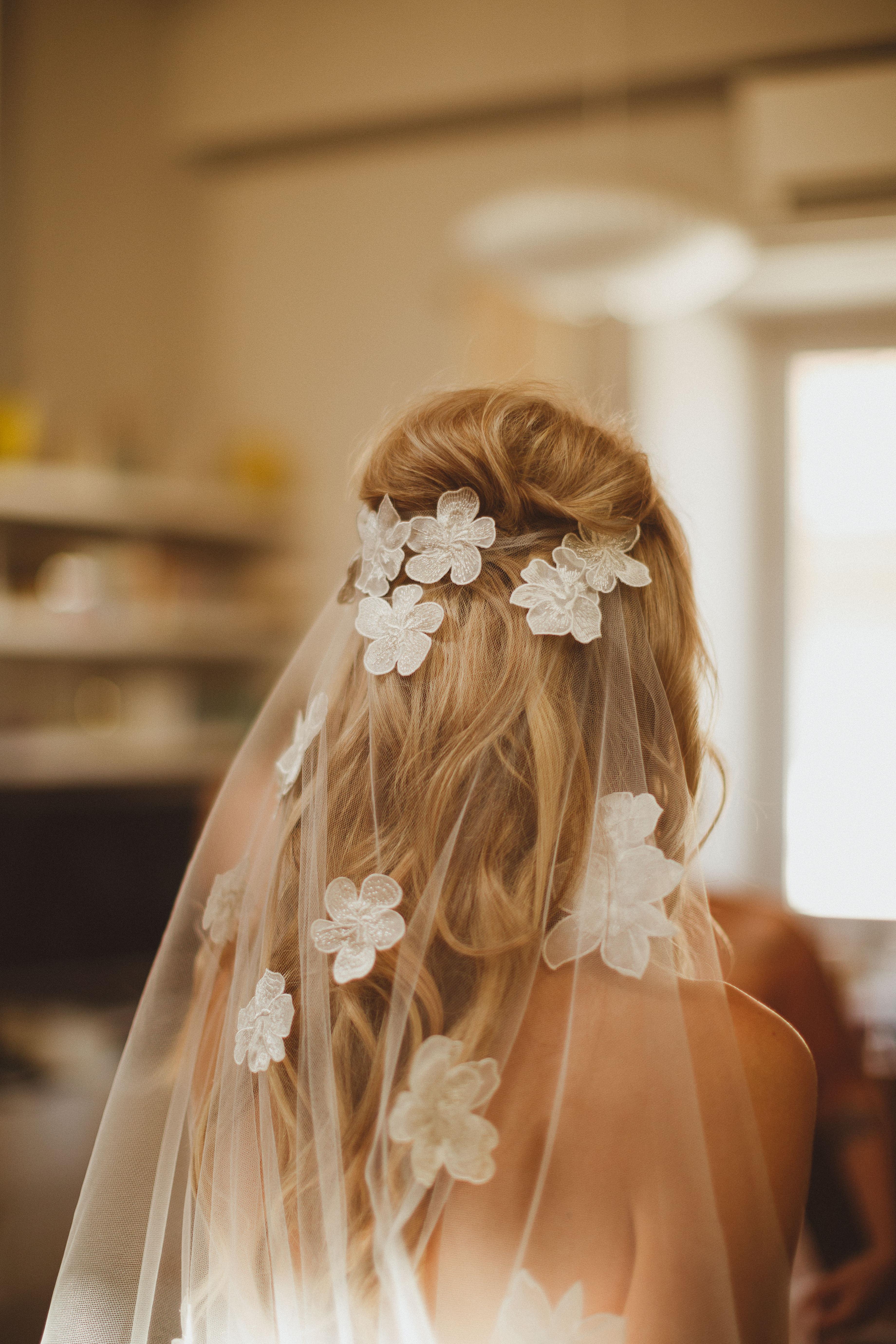 bride wearing veil with floral appliqués