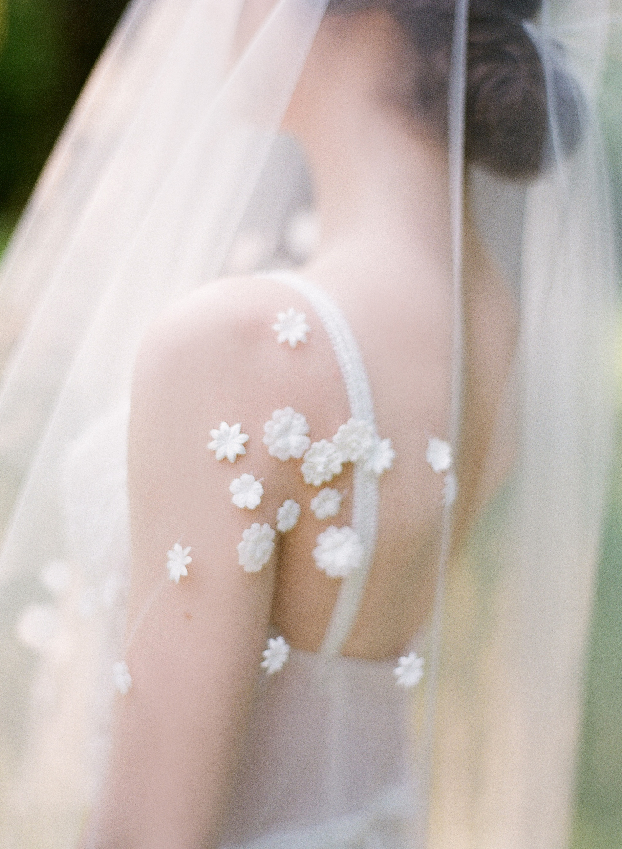 wedding veil with small floral appliqués
