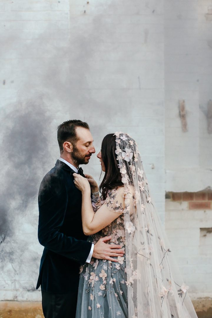 bride wearing colorful veil and wedding dress