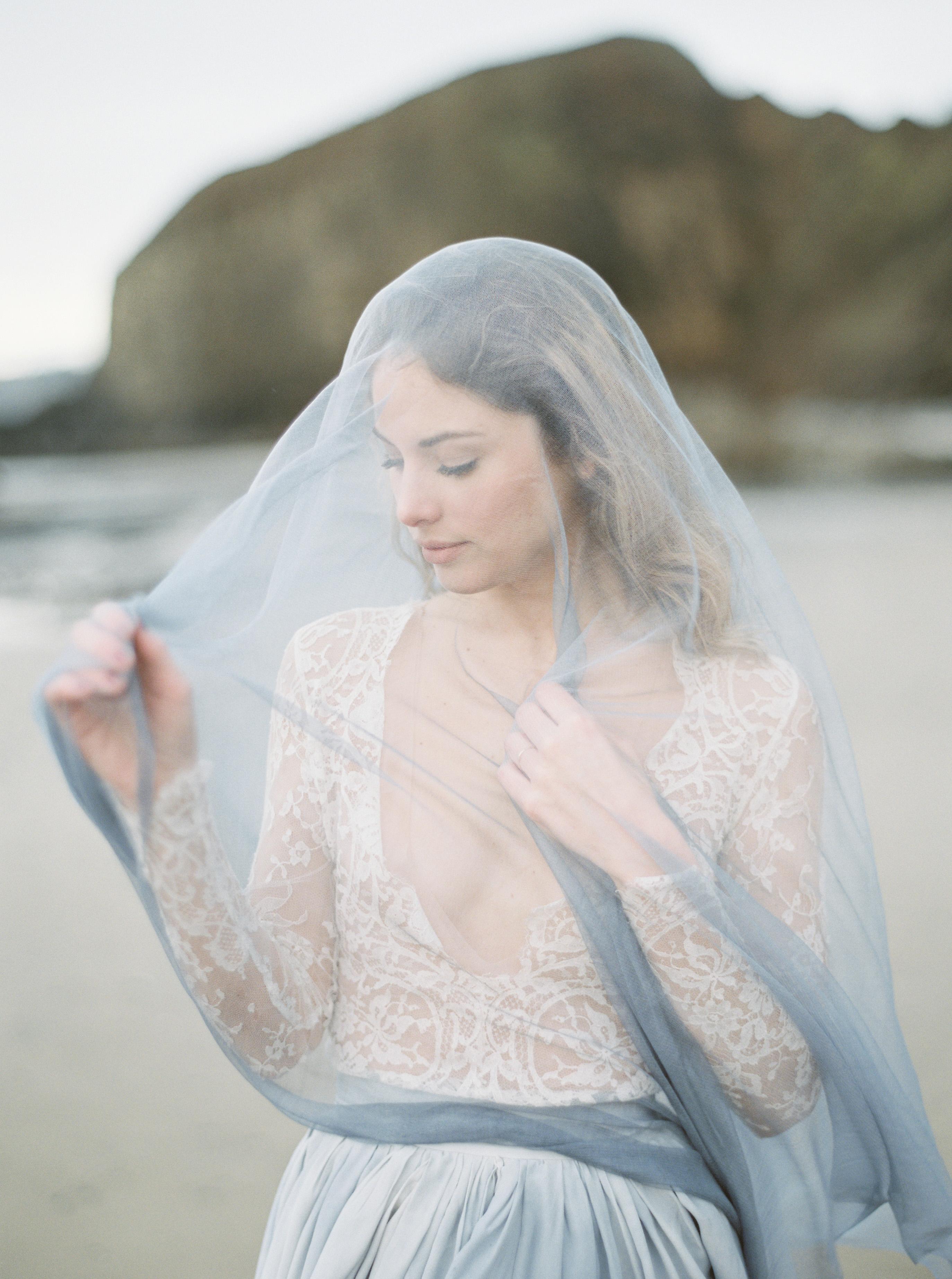 bride wearing dusty blue veil
