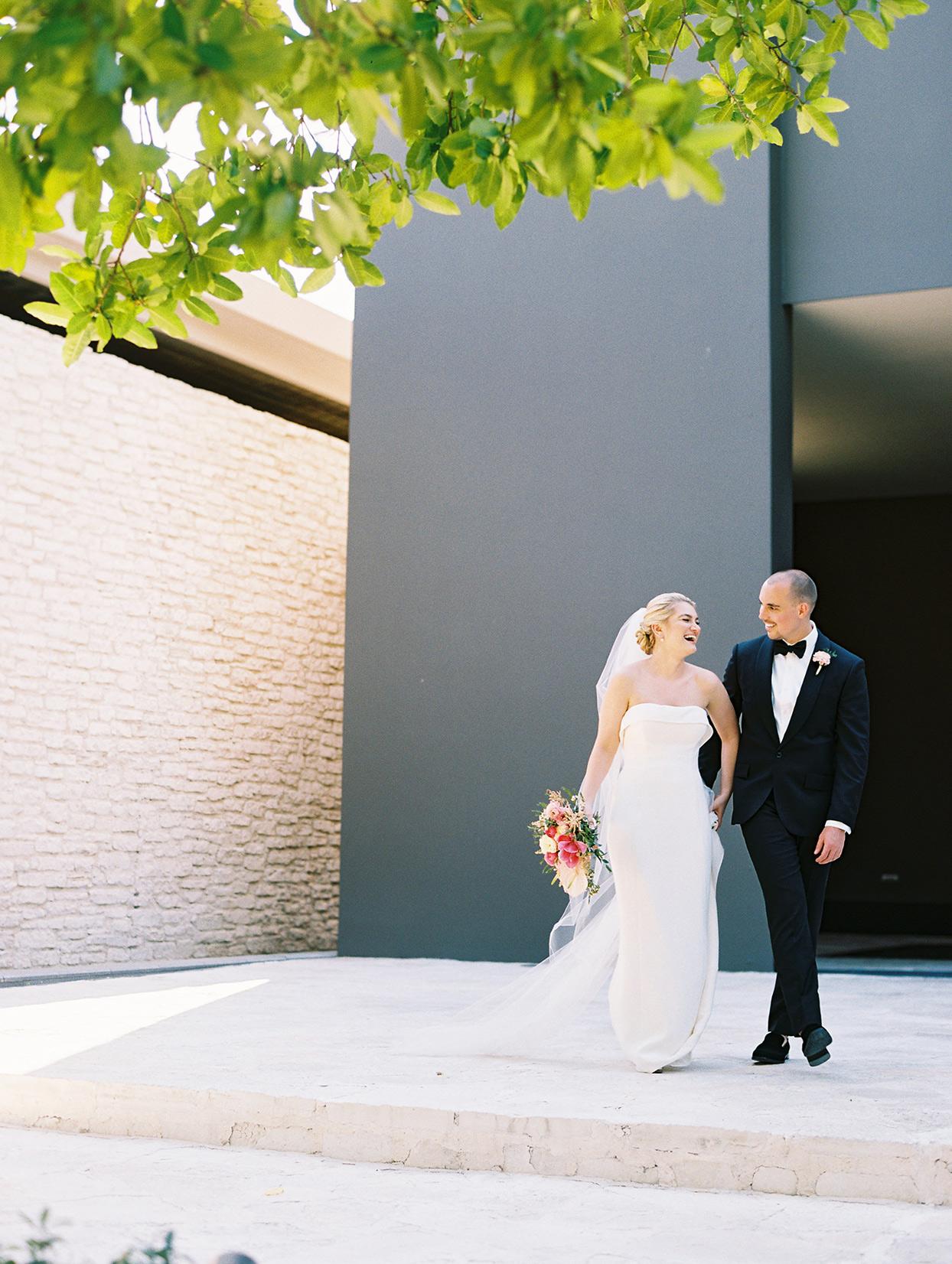 katie nick wedding couple in front of building
