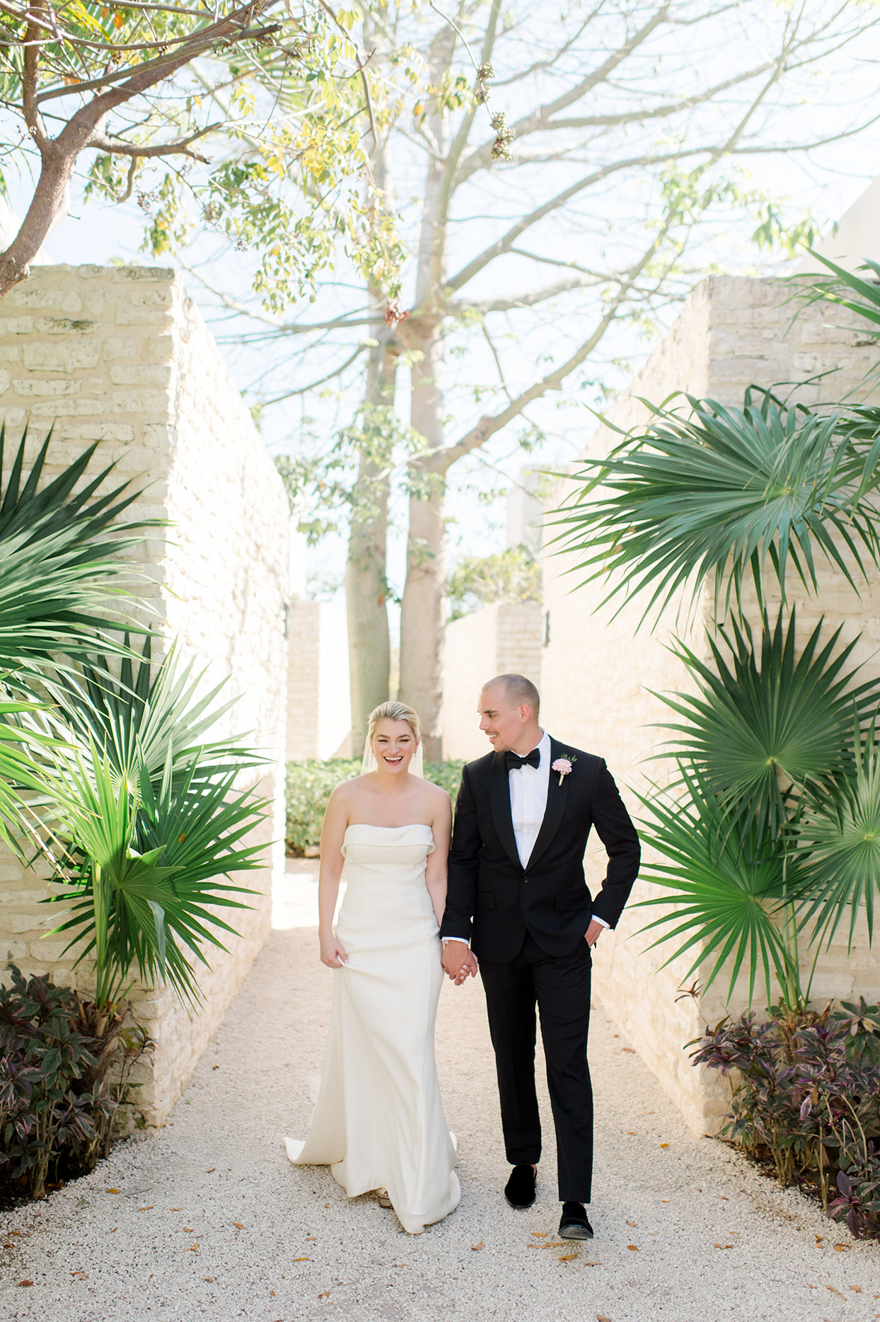 katie nick wedding couple walking through tropical garden
