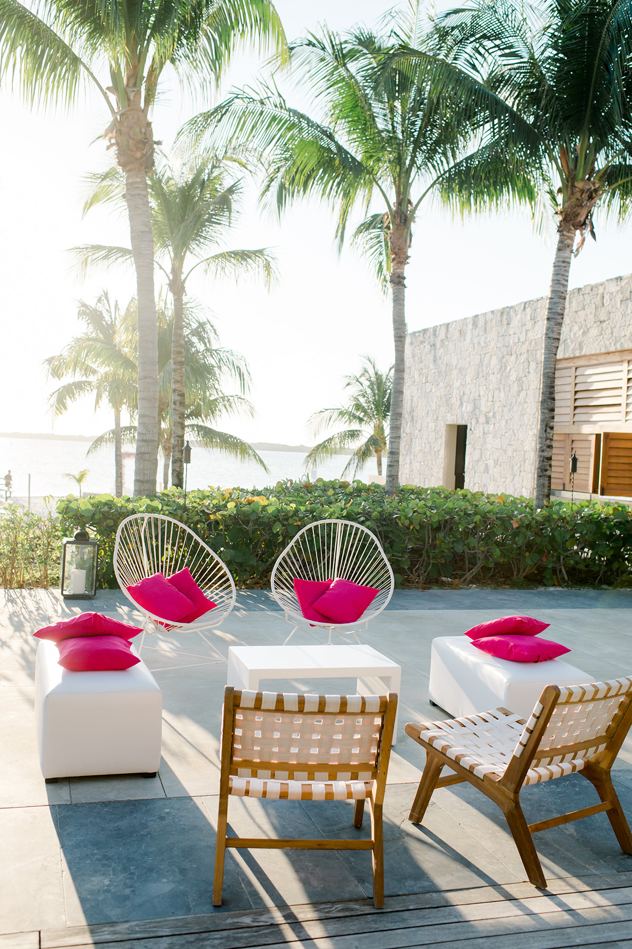 katie nick wedding lounge white chairs hot pink pillows