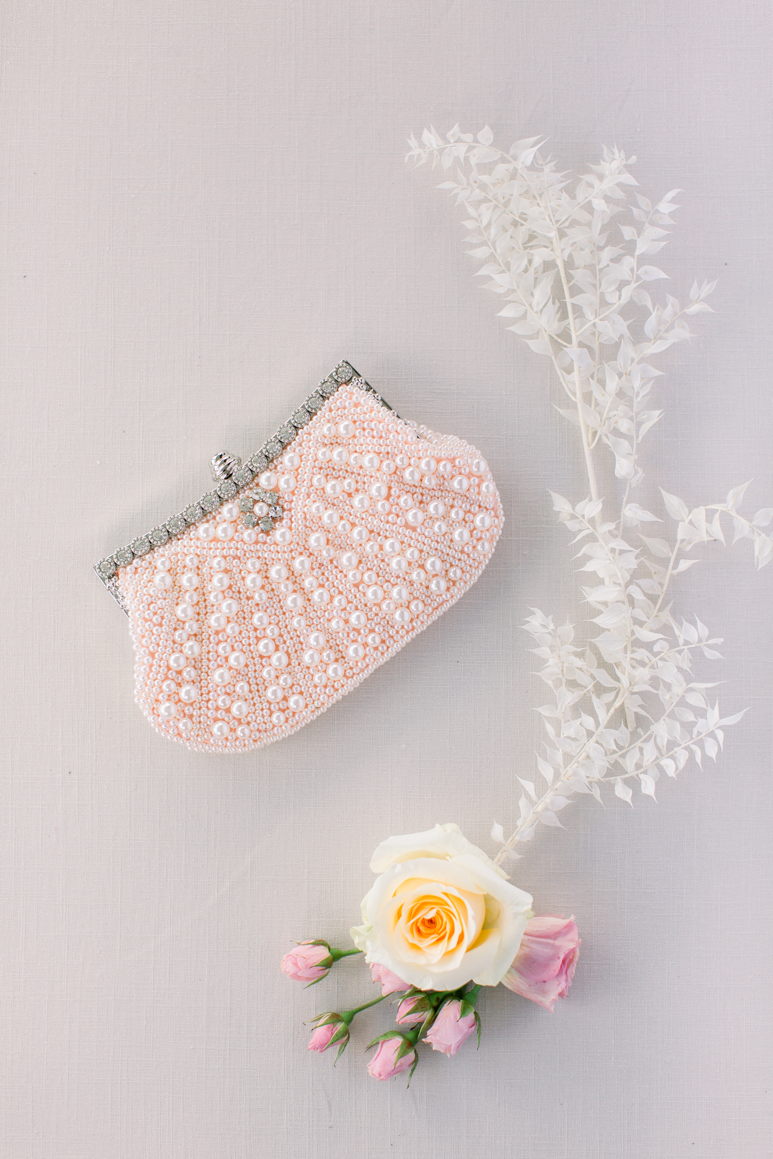 michelle nathan wedding bride's pink beaded clutch