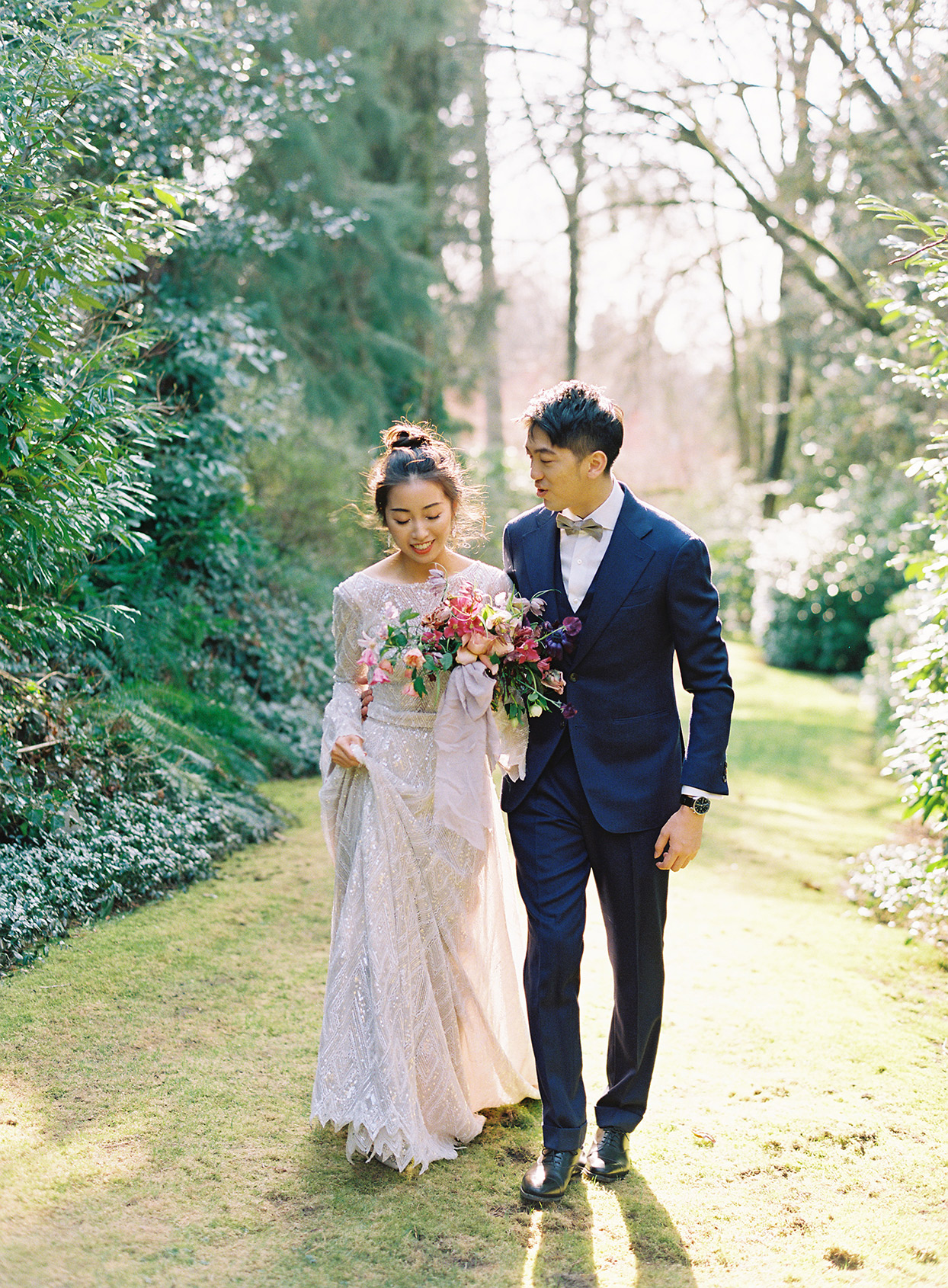 jackie ben wedding couple walking through garden