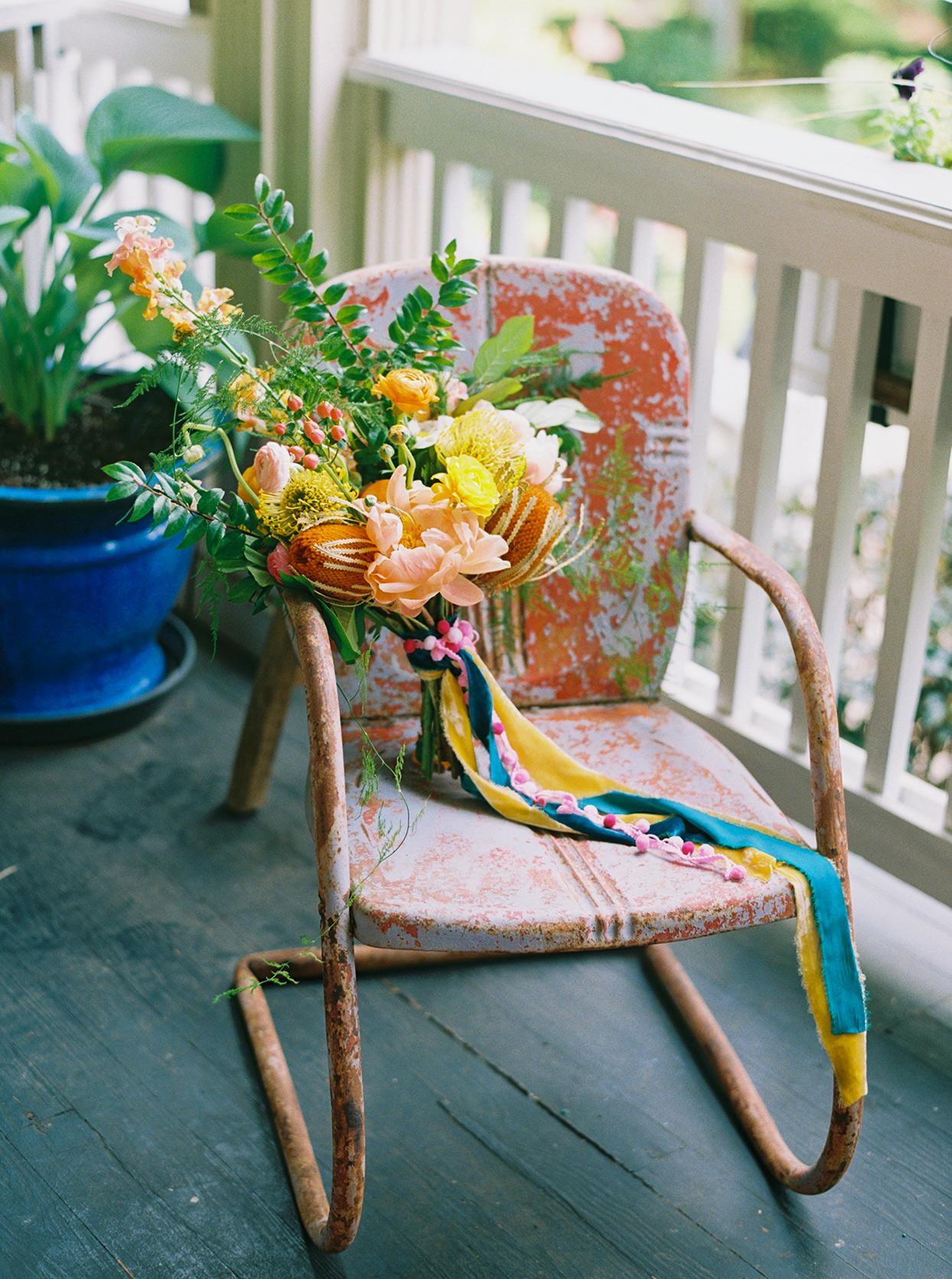 ashley scott colorful wedding bouquet on antique chair