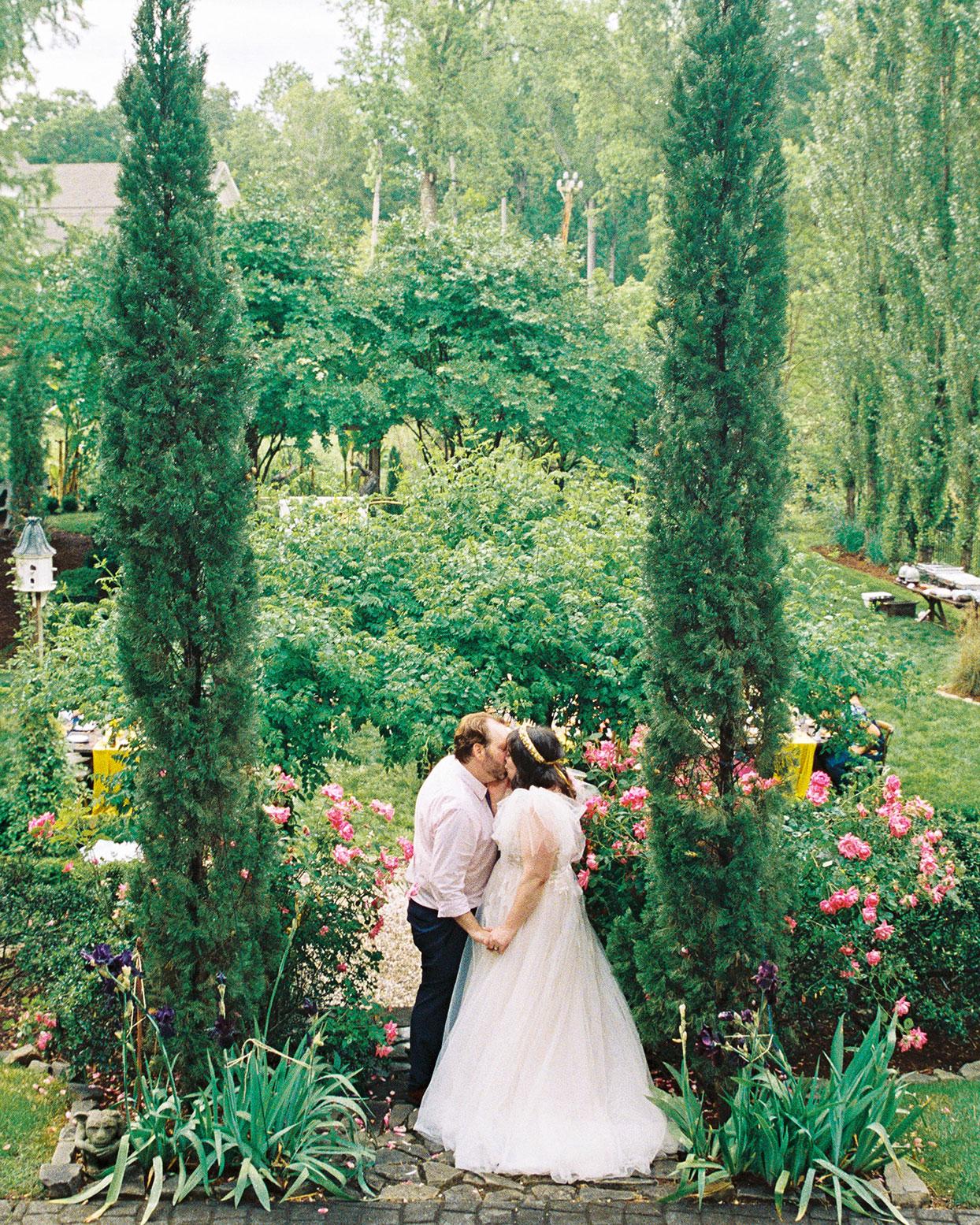 ashley scott wedding couple kiss in garden