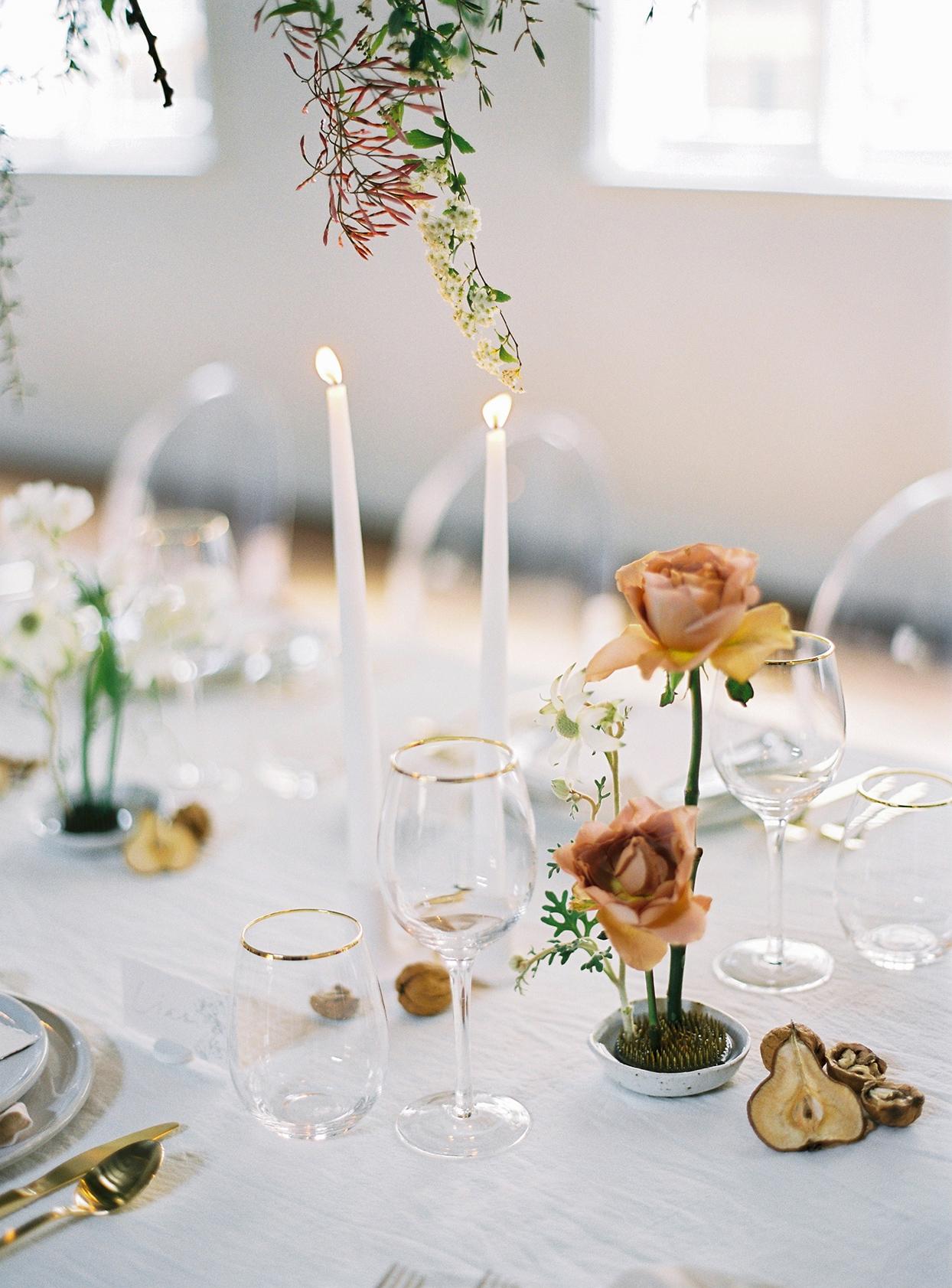 minimalist ikebana orange roses with table setting