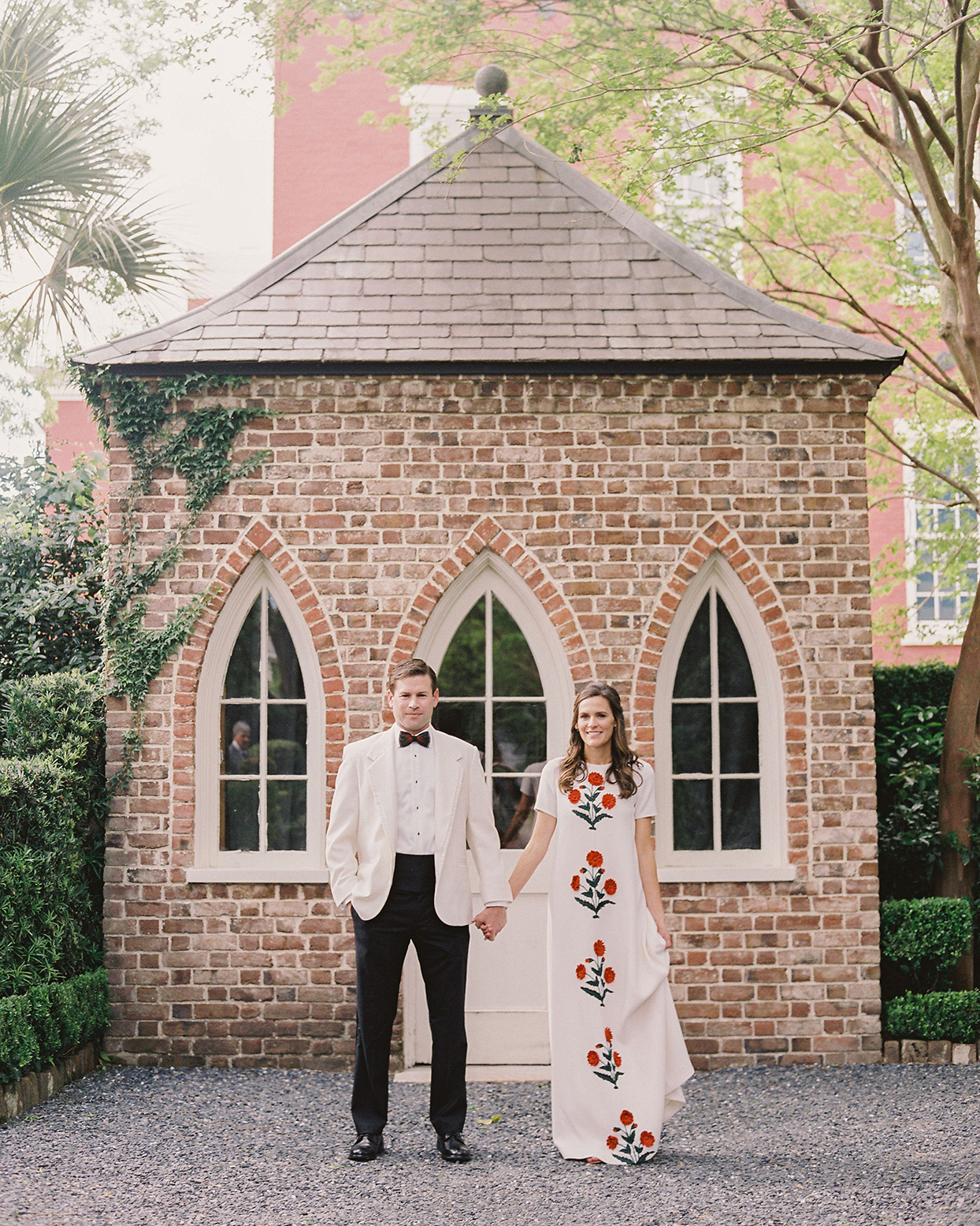 beverly steve wedding couple standing in front of garden house