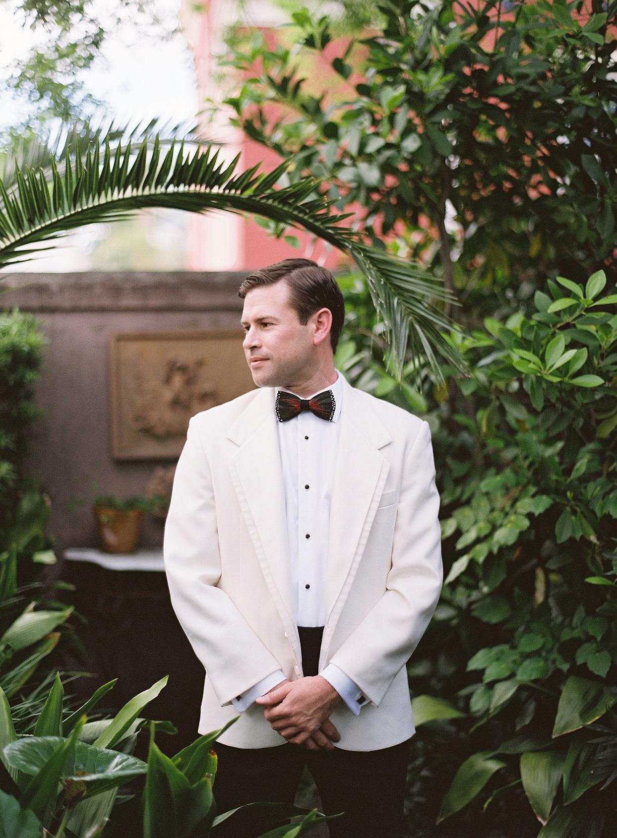beverly steve wedding groom in white suit jacket