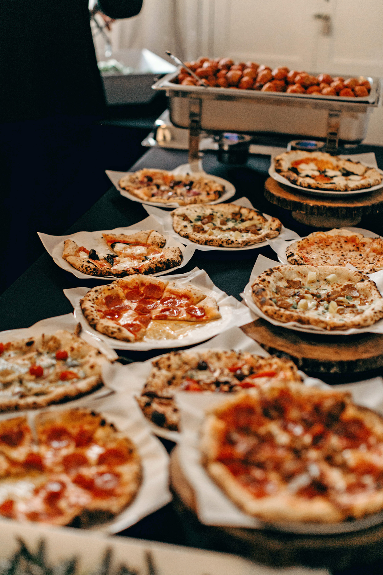 wedding grazing table filled with little pizzas