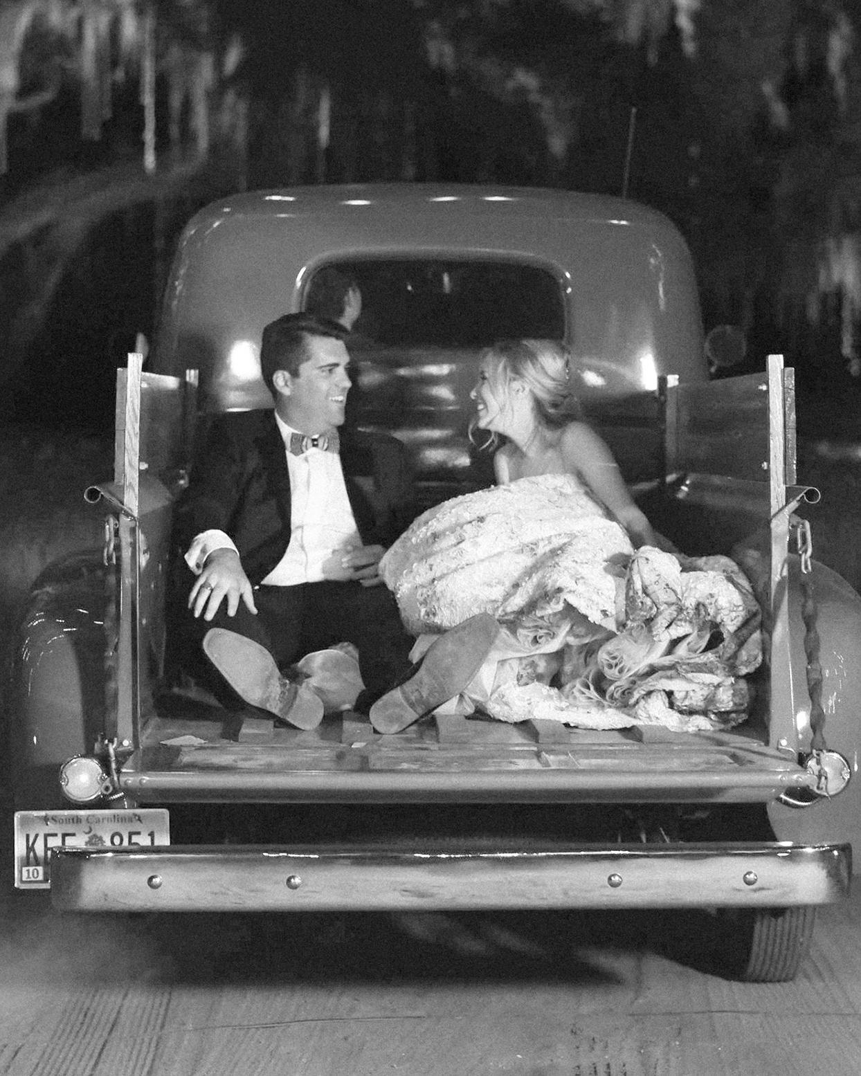 chelsea john wedding exit in back of pickup truck