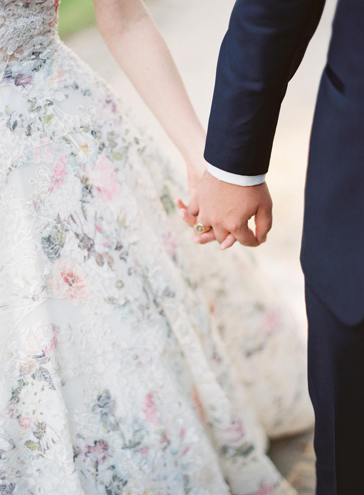 chelsea john wedding couple holding hands