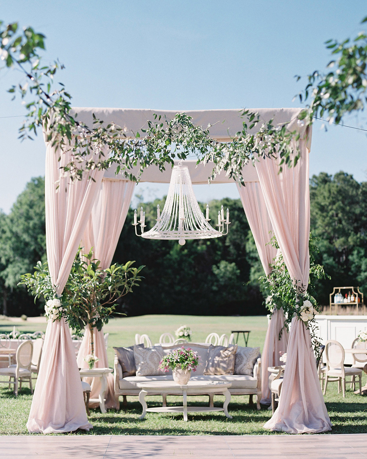 chelsea john wedding lounge with pastel tent