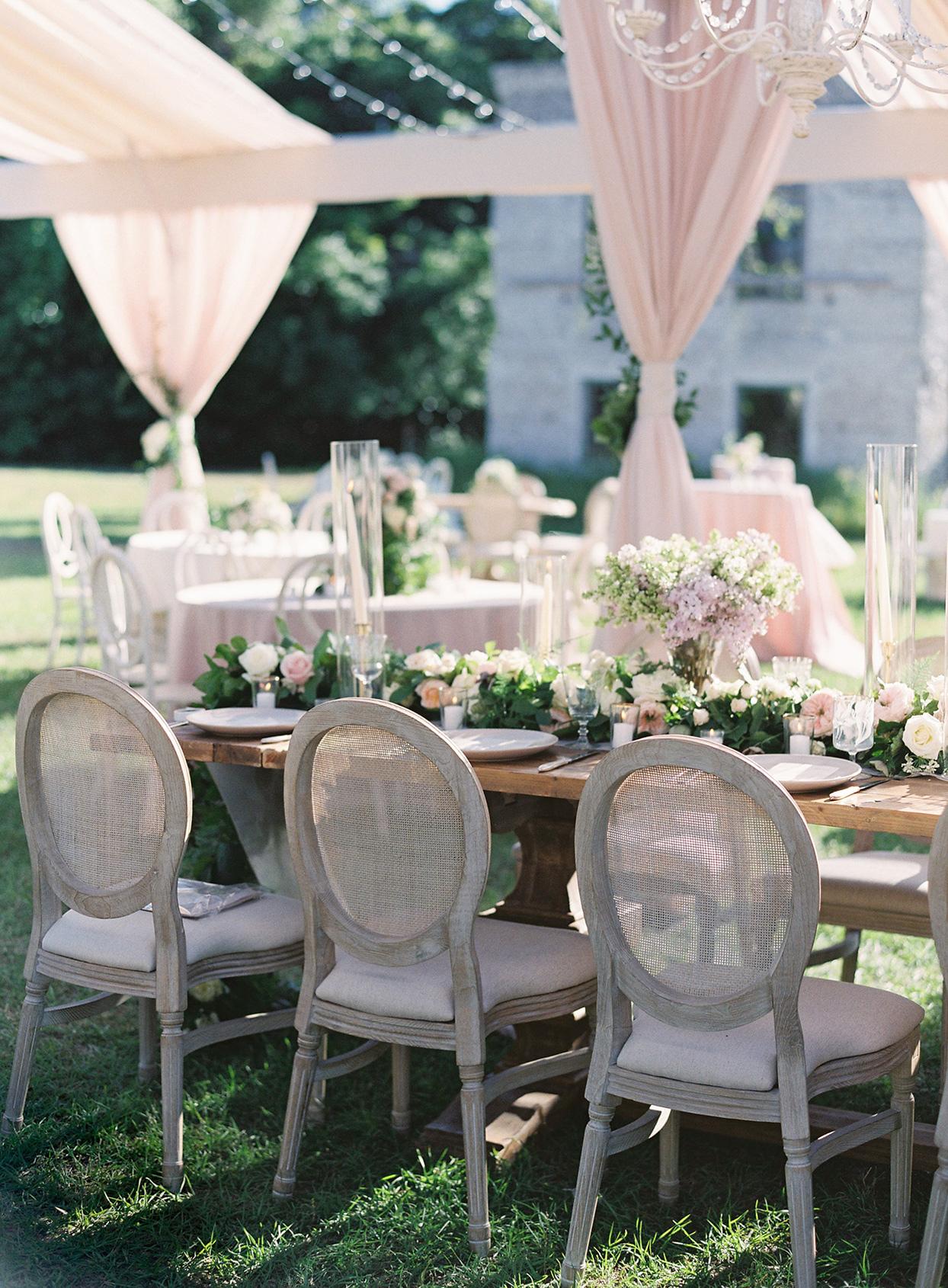 chelsea john wedding reception tables until pastel pink tent