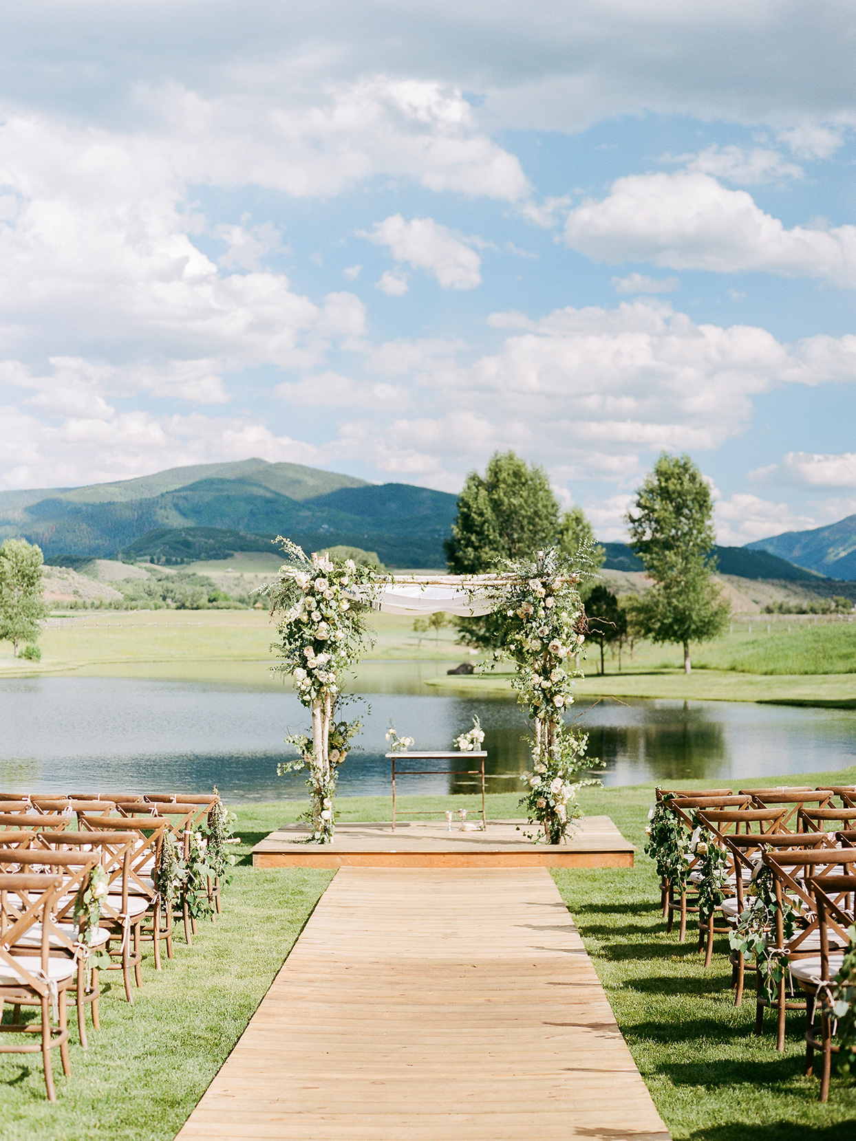 jessica aaron wedding ceremony location with water with mountain backdrop